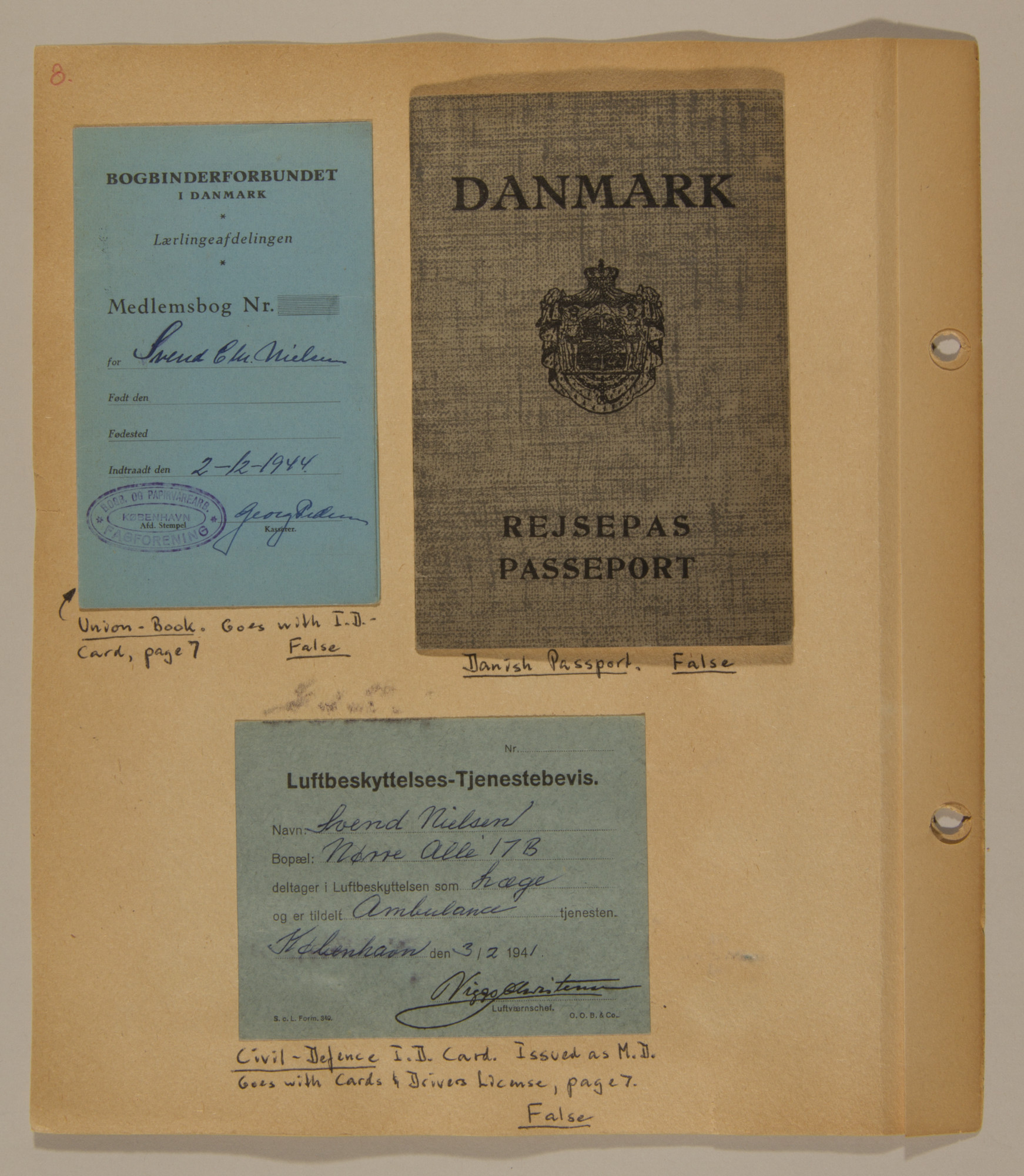 Page from volume three of a set of scrapbooks compiled by Bjorn Sibbern, a Danish policeman and resistance member, documenting the German occupation of Denmark.  This page contains Bjorn Sibbern's (aka Svend Nieslsen's) false identification cards.