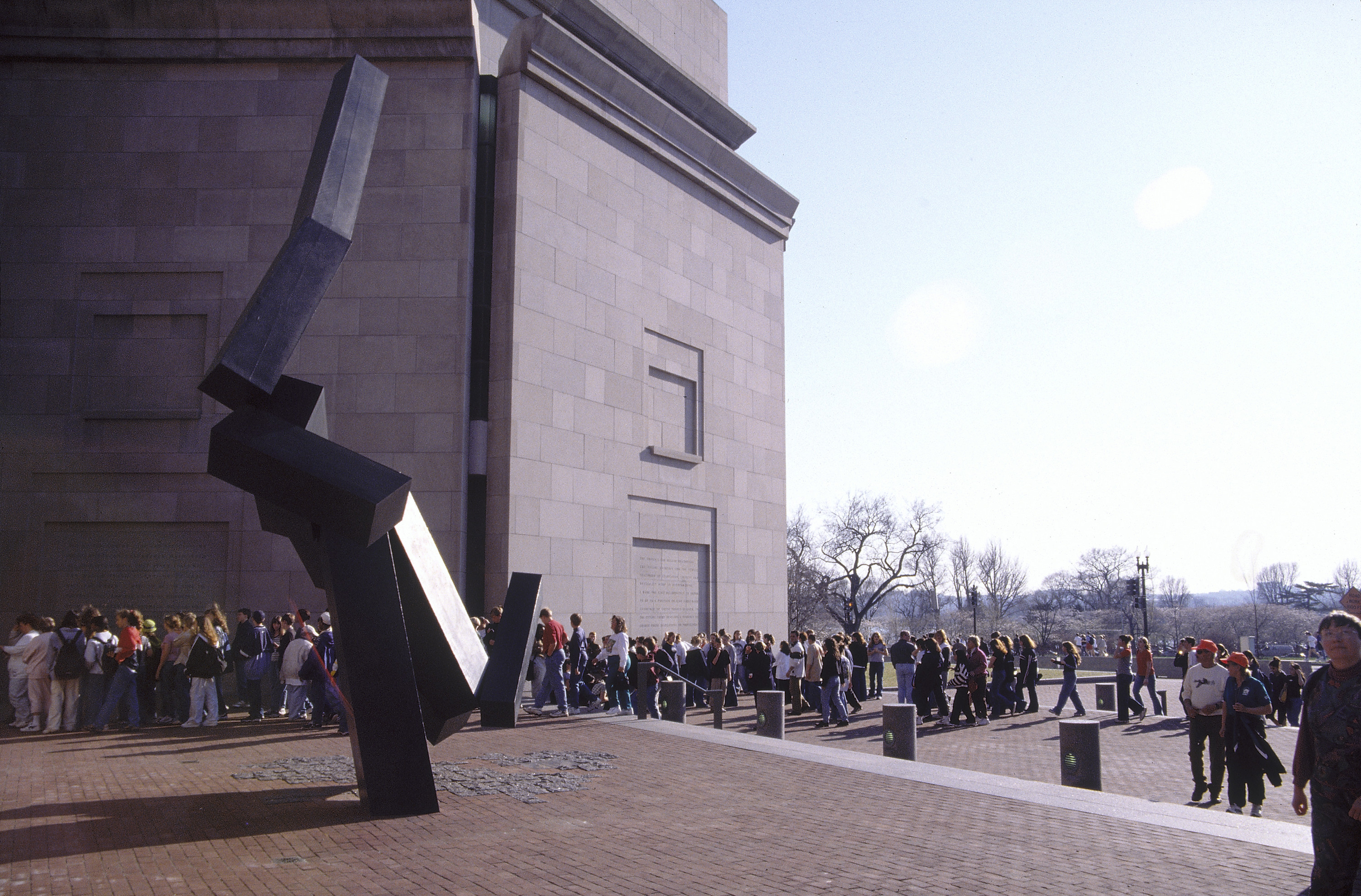 Visitors get into line at the 15th Street entrance to the U.S. Holocaust Memorial Museum.