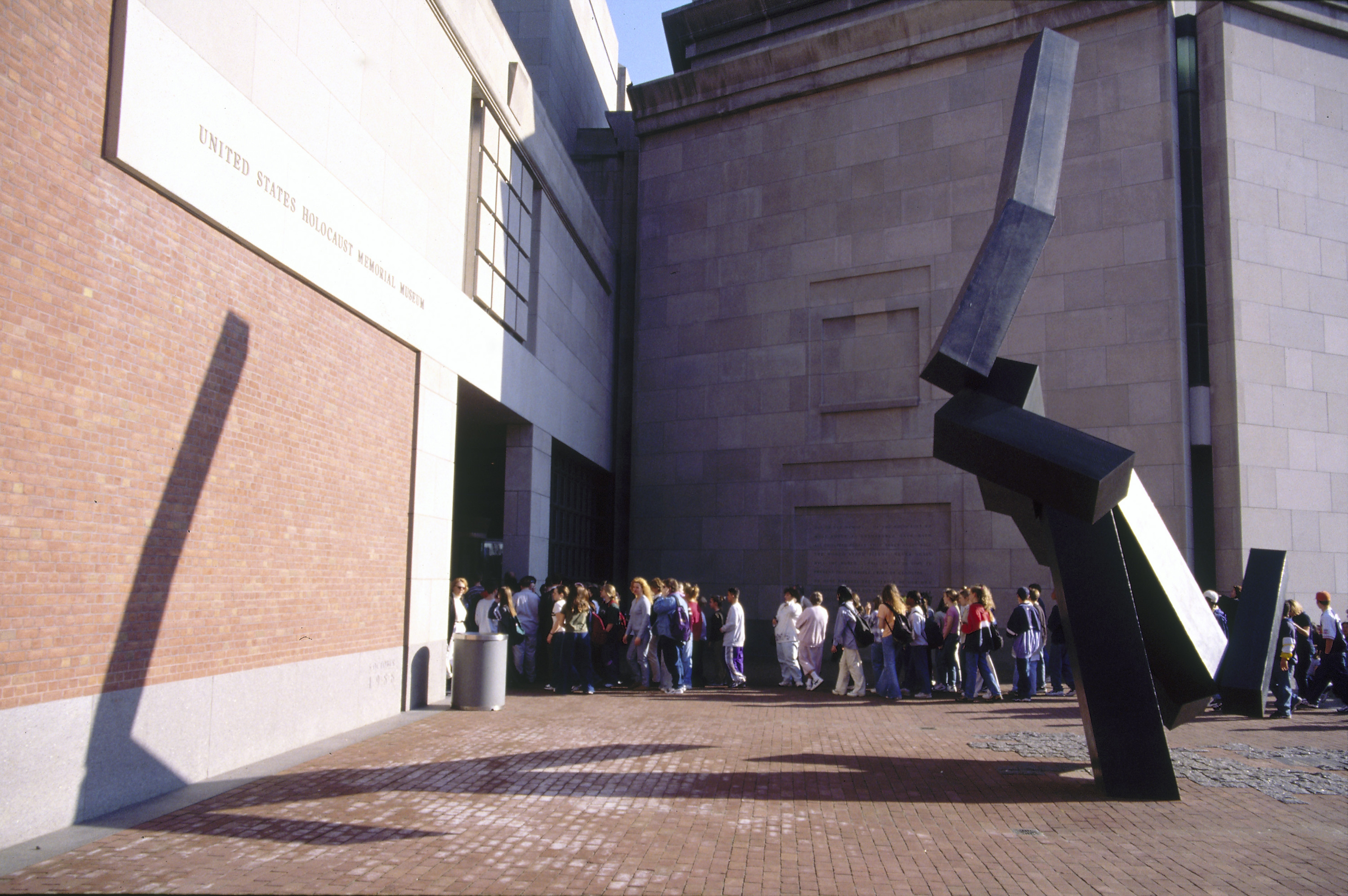 Visitors wait in line at the 15th Street entrance to the U.S. Holocaust Memorial Museum.
