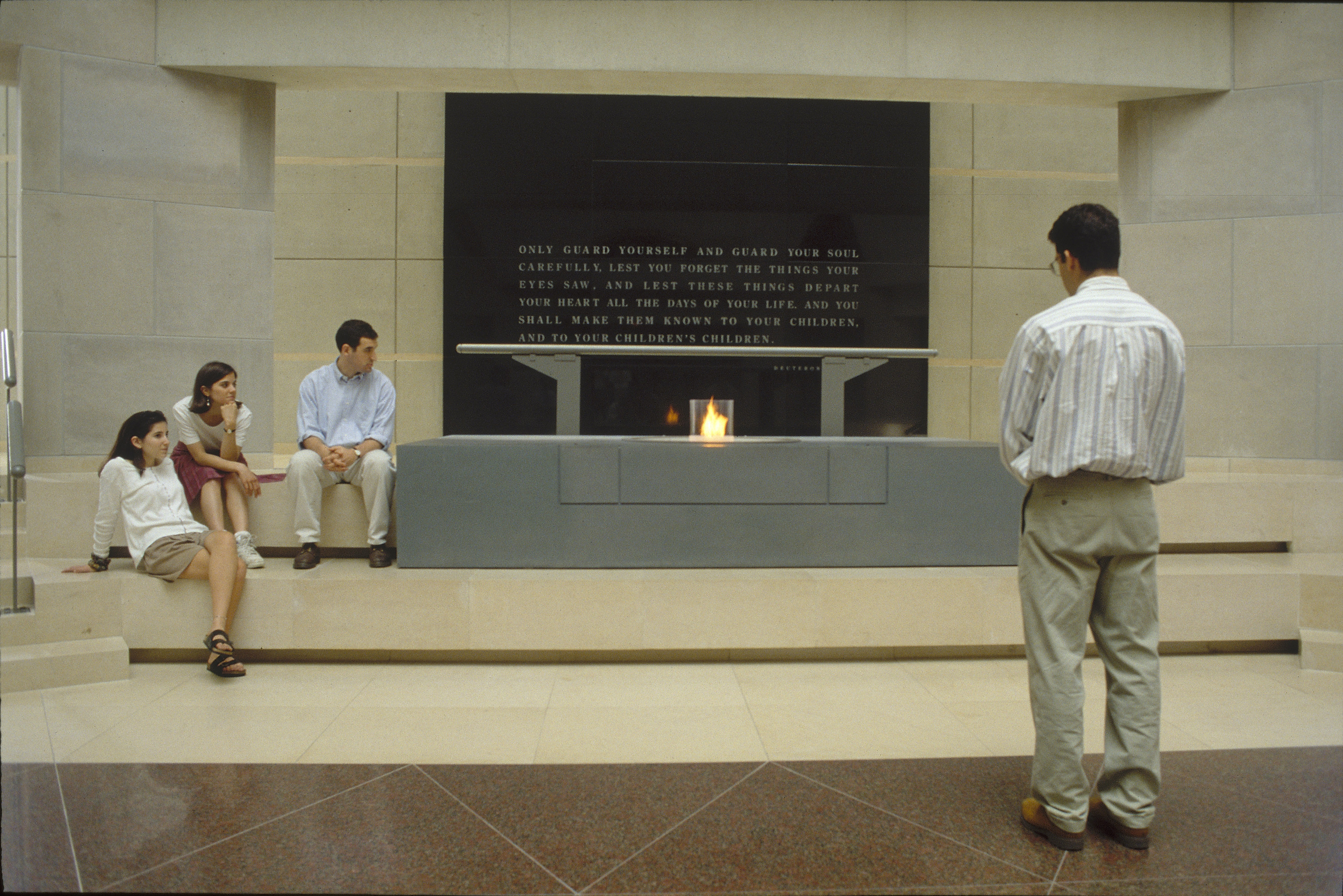 Visitors view the eternal flame in the Hall of Remembrance at the U.S. Holocaust Memorial Museum.