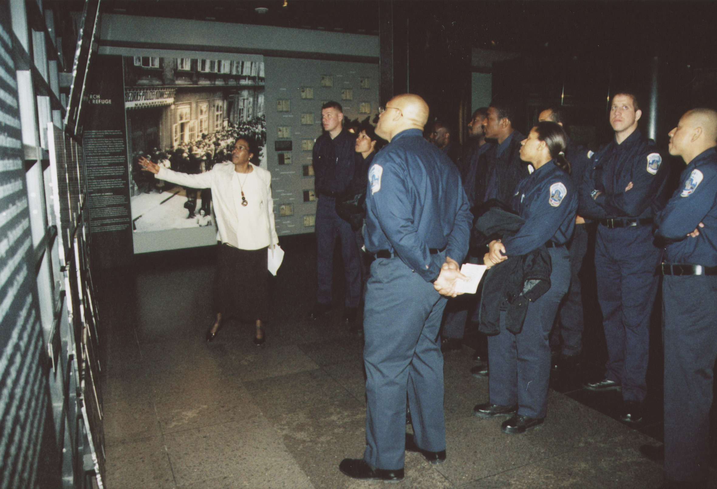 DC police training squad visits the U.S. Holocaust Memorial Museum.  Lynn Williams guides a tour through the Permanent Exhibition.