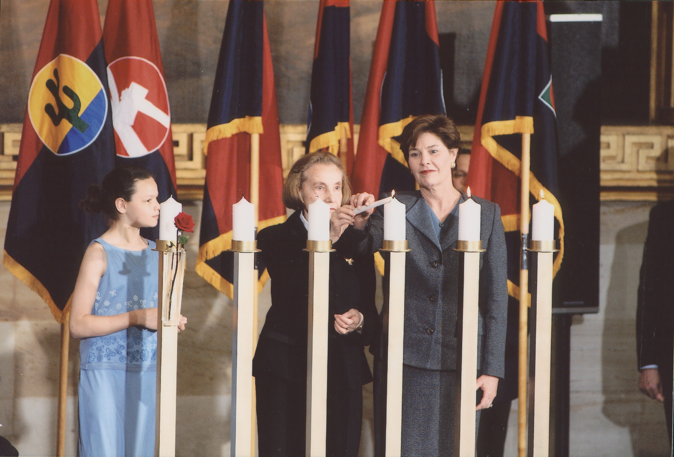 Laura Bush and Vladka Meed light a candle at the 2001 Days of Remembrance ceremony, U.S. Capitol Rotunda.