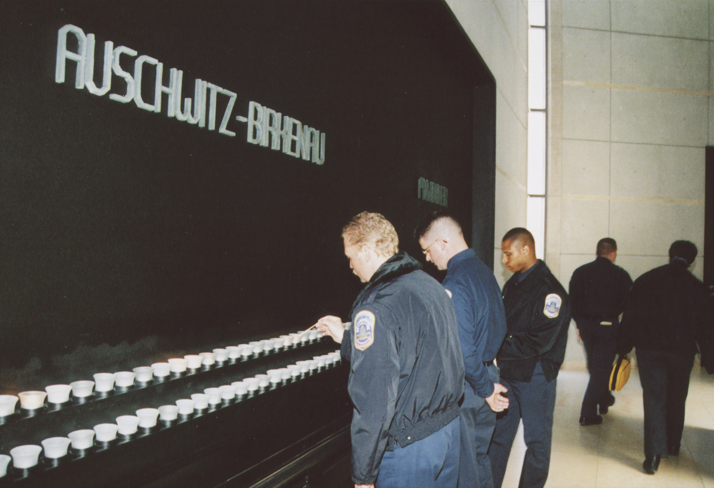 DC police training squad visits the U.S. Holocaust Memorial Museum.  Officers light candles in the Hall of Remembrance.