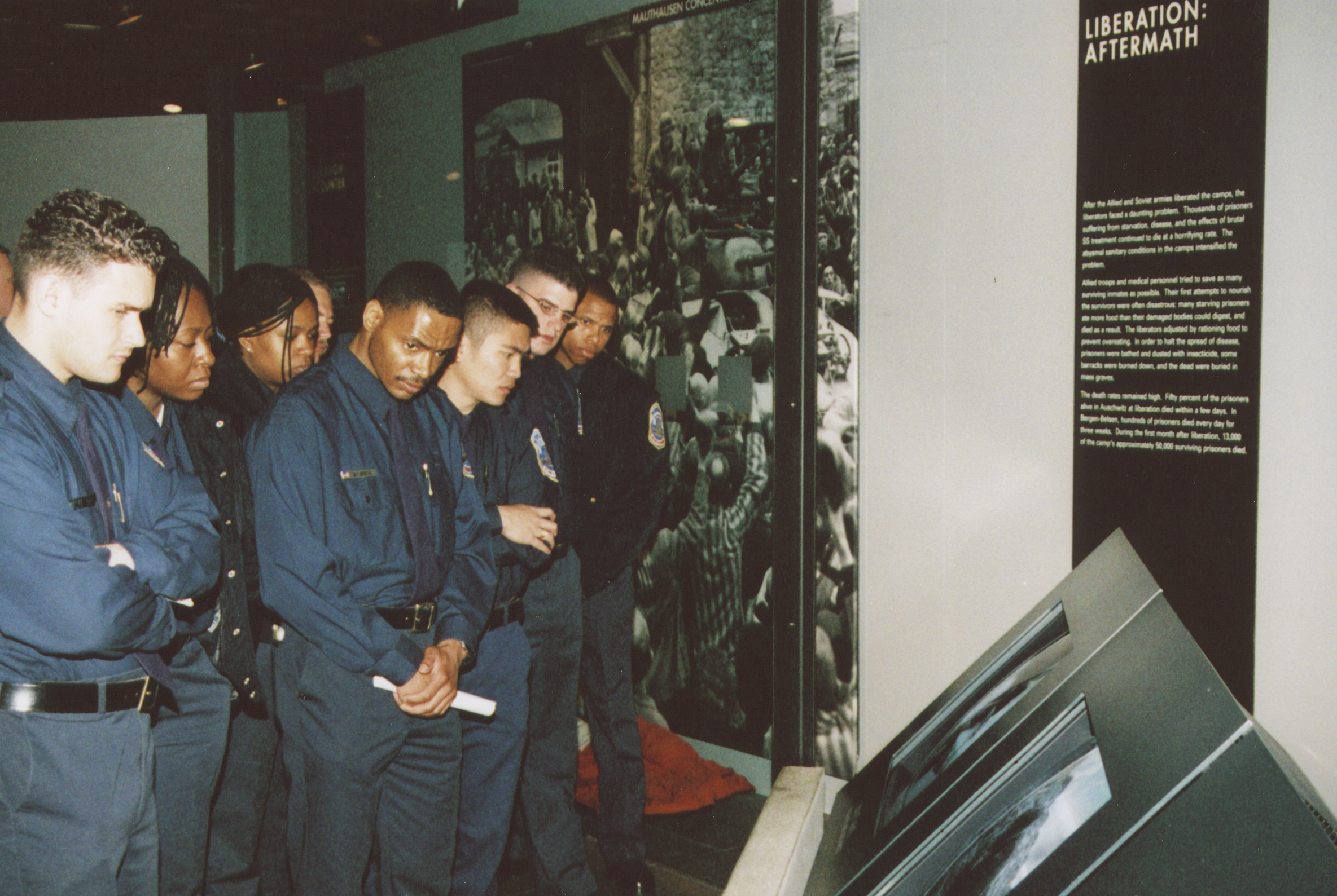 DC police training squad visits the U.S. Holocaust Memorial Museum.  Officers view the Liberation segment of the Permanent Exhibition.