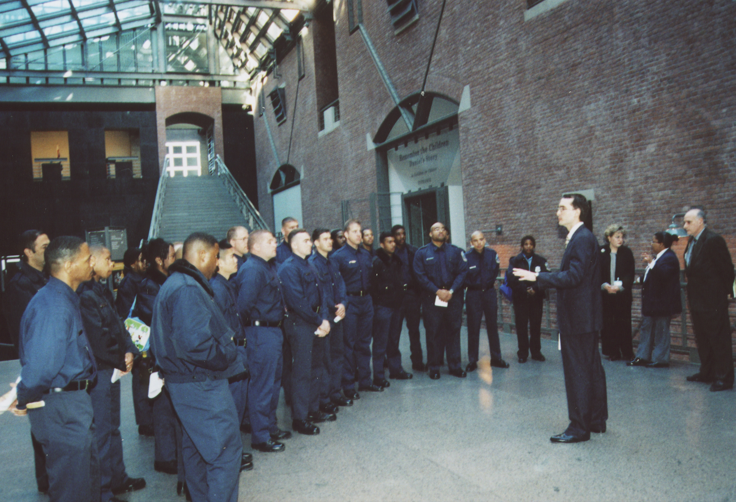 DC police training squad visits the U.S. Holocaust Memorial Museum.   Andres Abril begins the tour by speaking to the officers in the Hall of Witness.