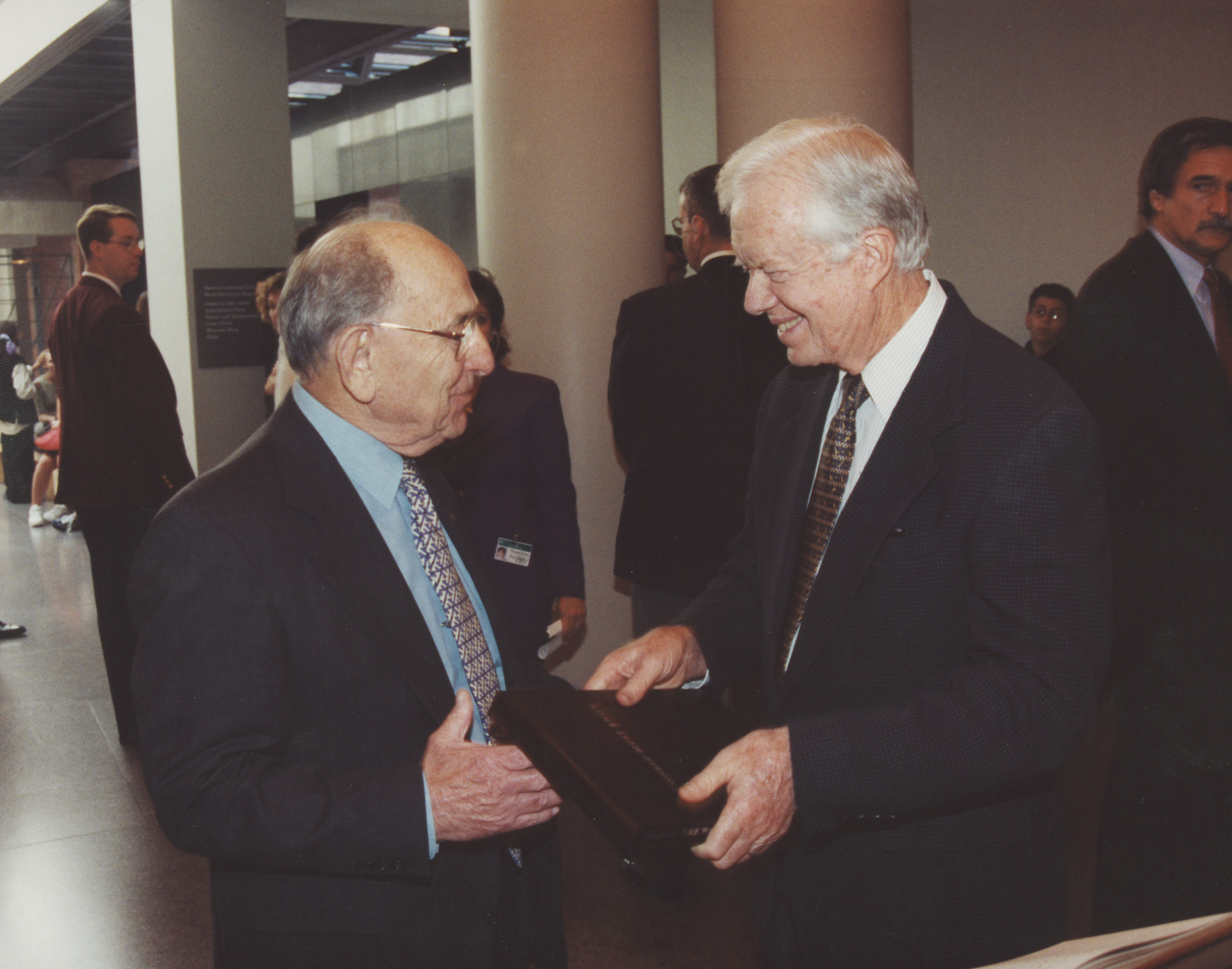 Miles Lerman and Jimmy Carter exchange gifts during Jimmy Carter's visit to the United States Holocaust Memorial Museum.