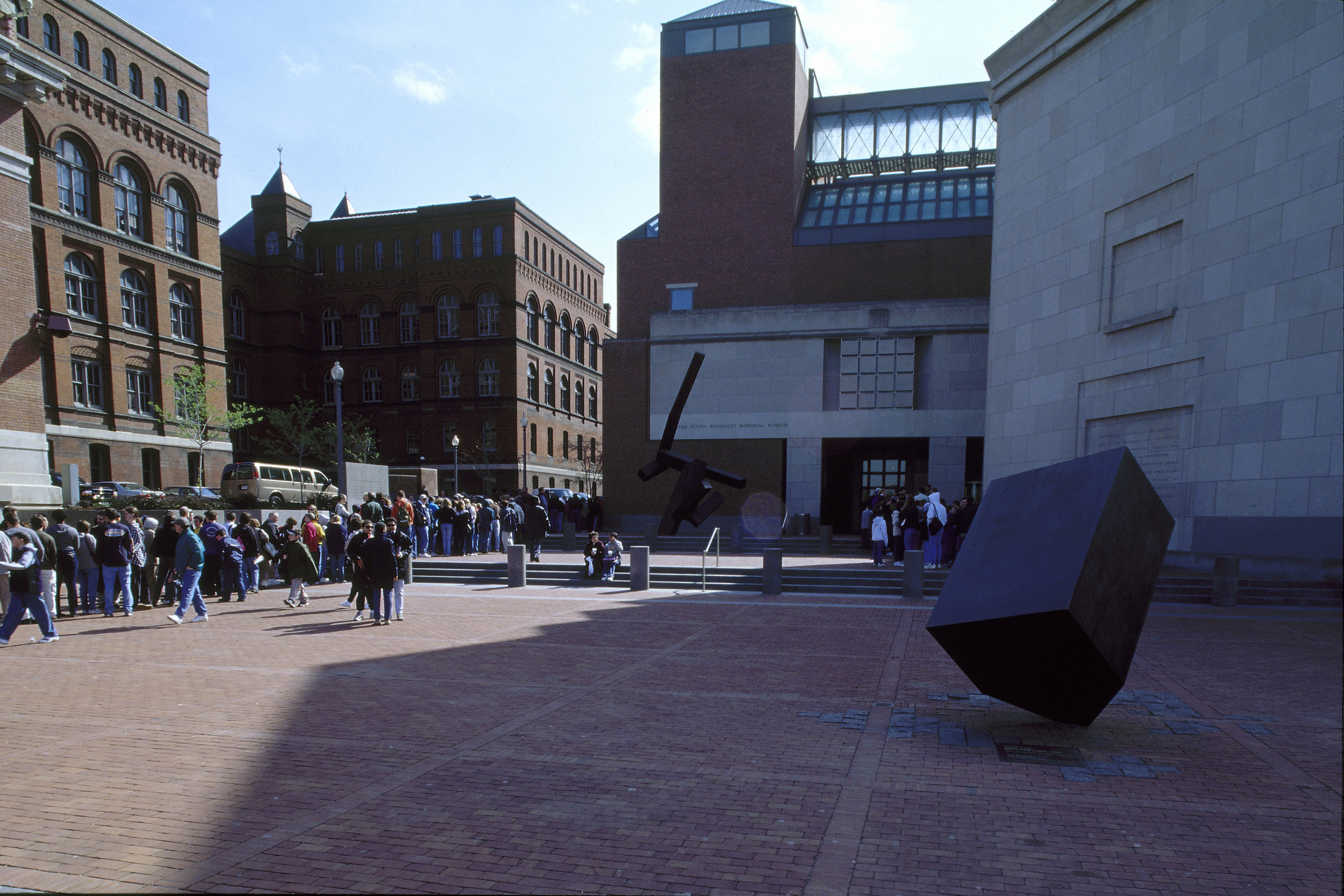 Visitors walk through the Eisenhower Plaza on their way to the U.S. Holocaust Memorial Museum.