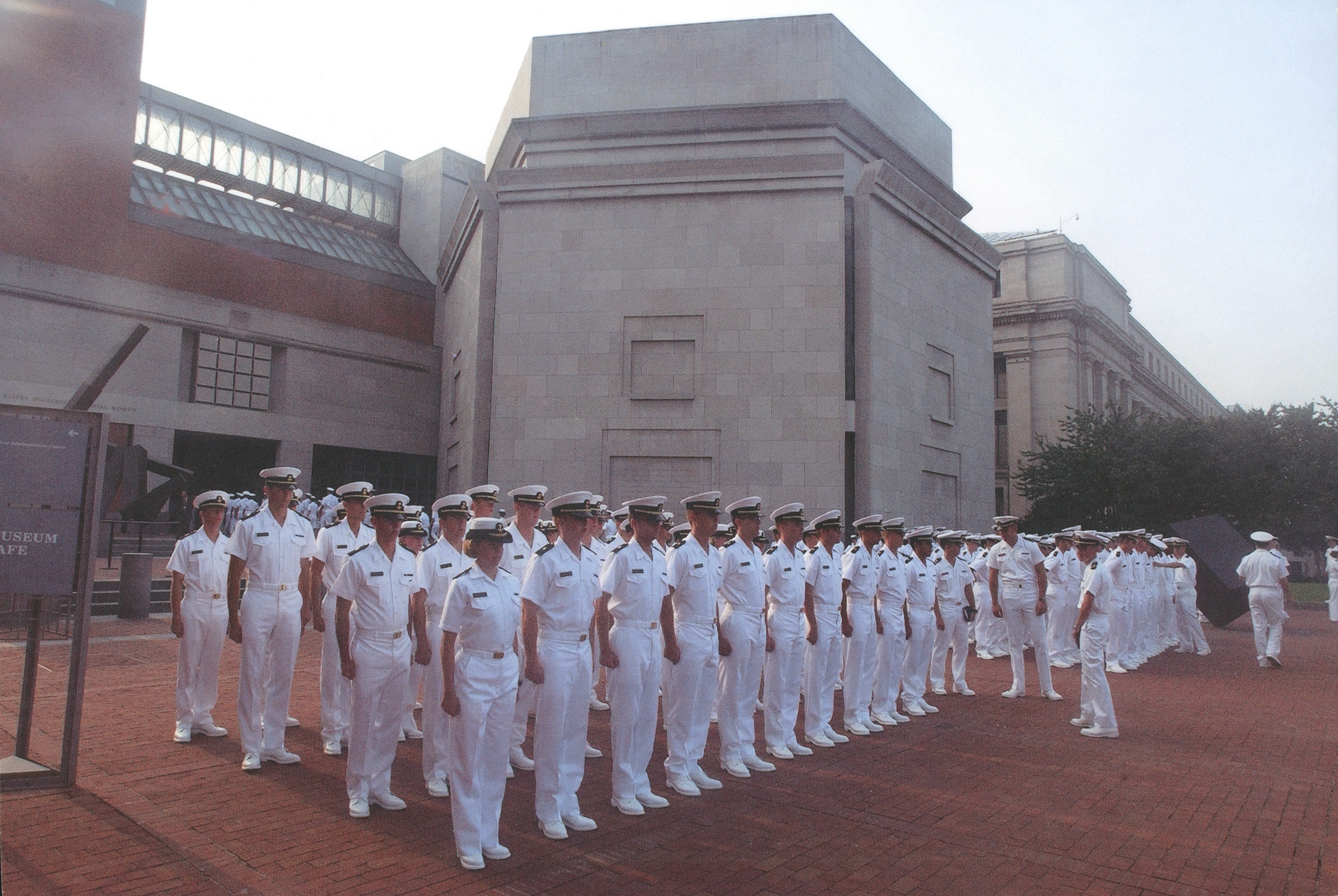 U.S. Naval Academy midshipmen stand in formation in front of the U.S. Holocaust Memorial Museum.