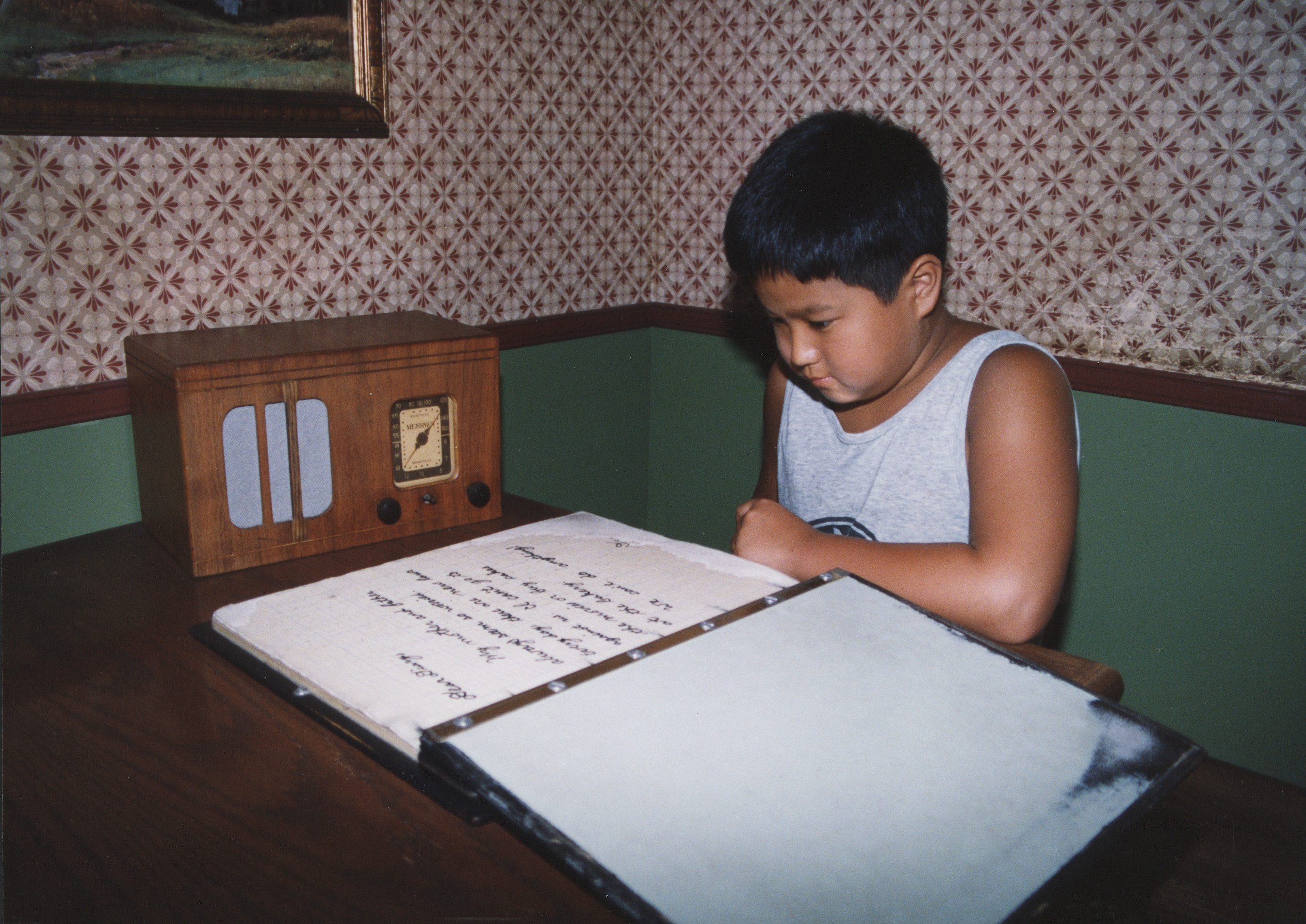 "A young visitor reads Daniel's diary while touring the ""Remember the Children"" exhibition at the U.S. Holocaust Memorial Museum."