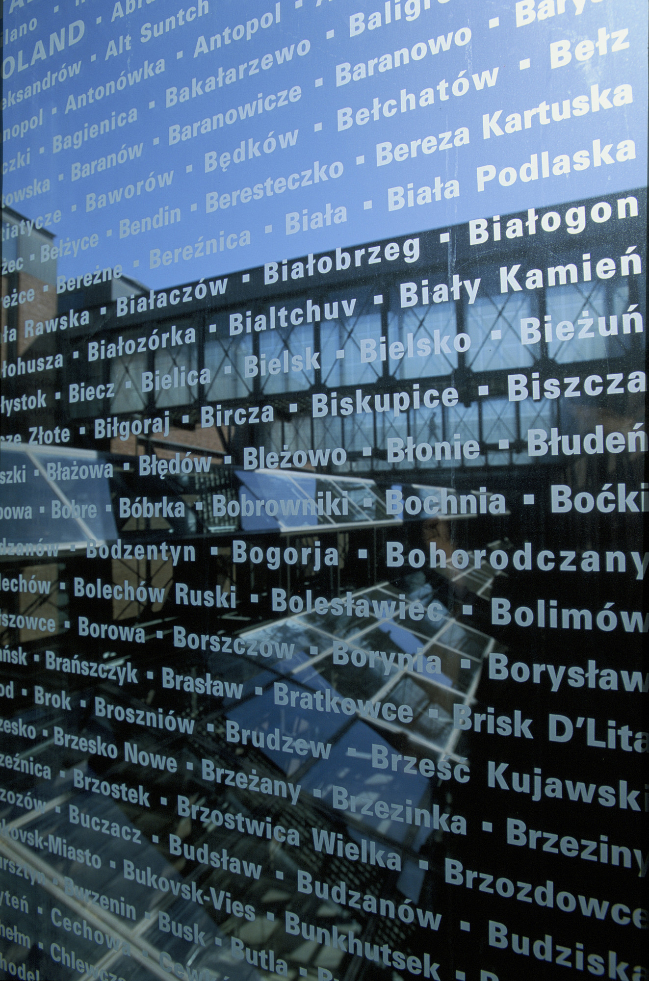 One panel of glass etched with the names of lost Jewish communities that lines the bridge in the permanent exhibition of the U.S. Holocaust Memorial Museum.