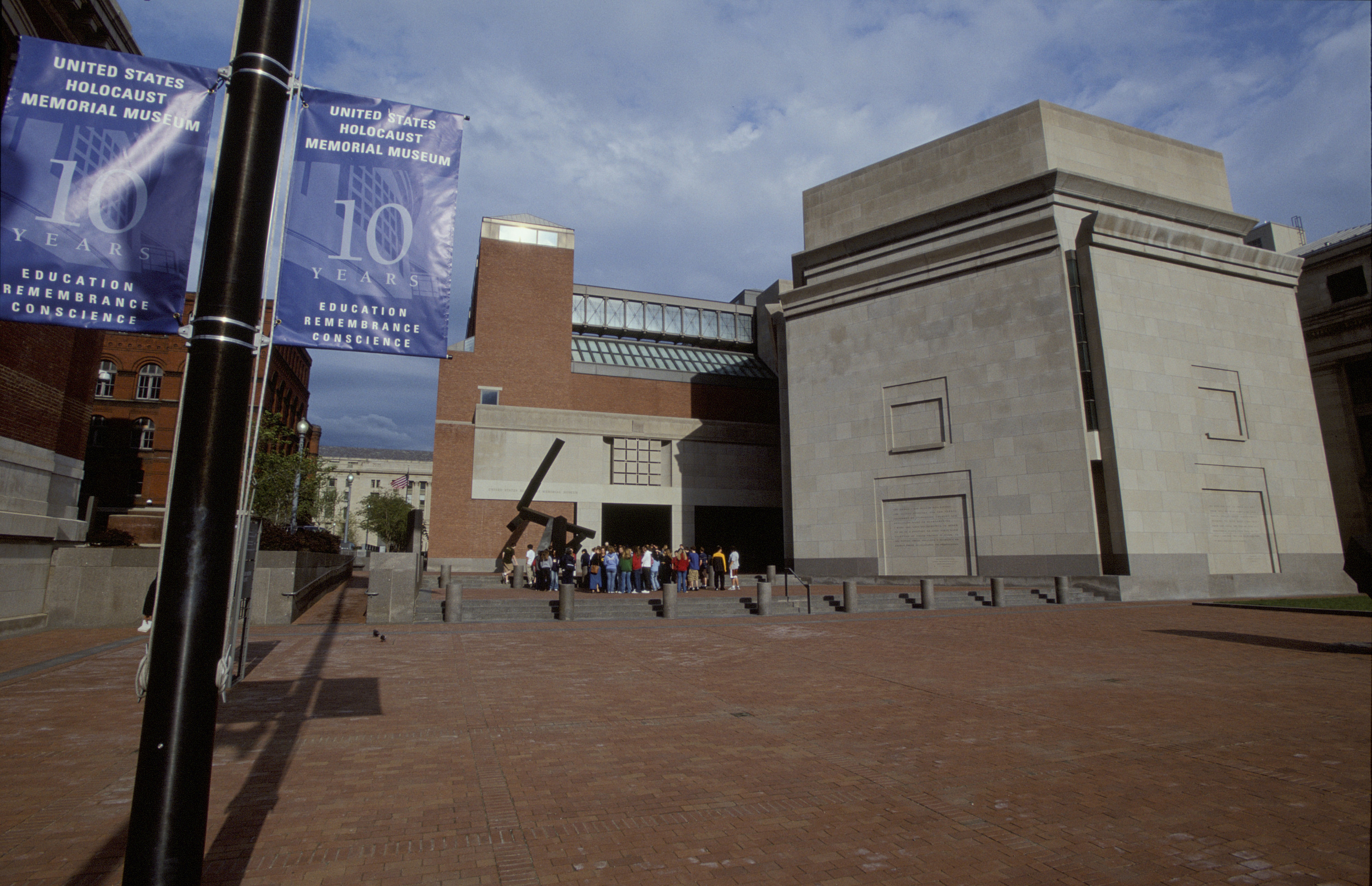 View of Eisenhower Plaza decorated with 10th anniversary banners on the flag pole at the U.S. Holocaust Memorial Museum on the day of its10th anniversary.