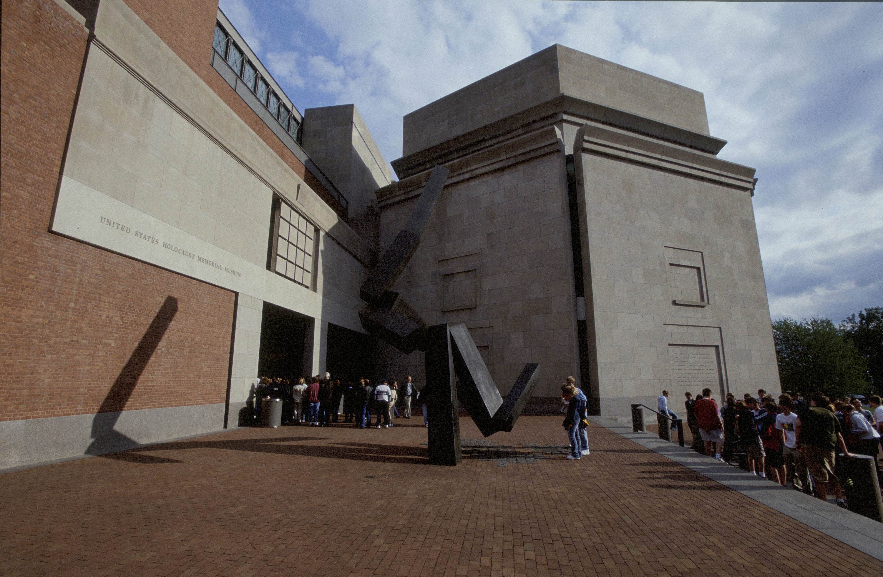 Visitors gather in Eisenhower Plaza outside the U.S. Holocaust Memorial Museum on the day of its 10th anniversary.