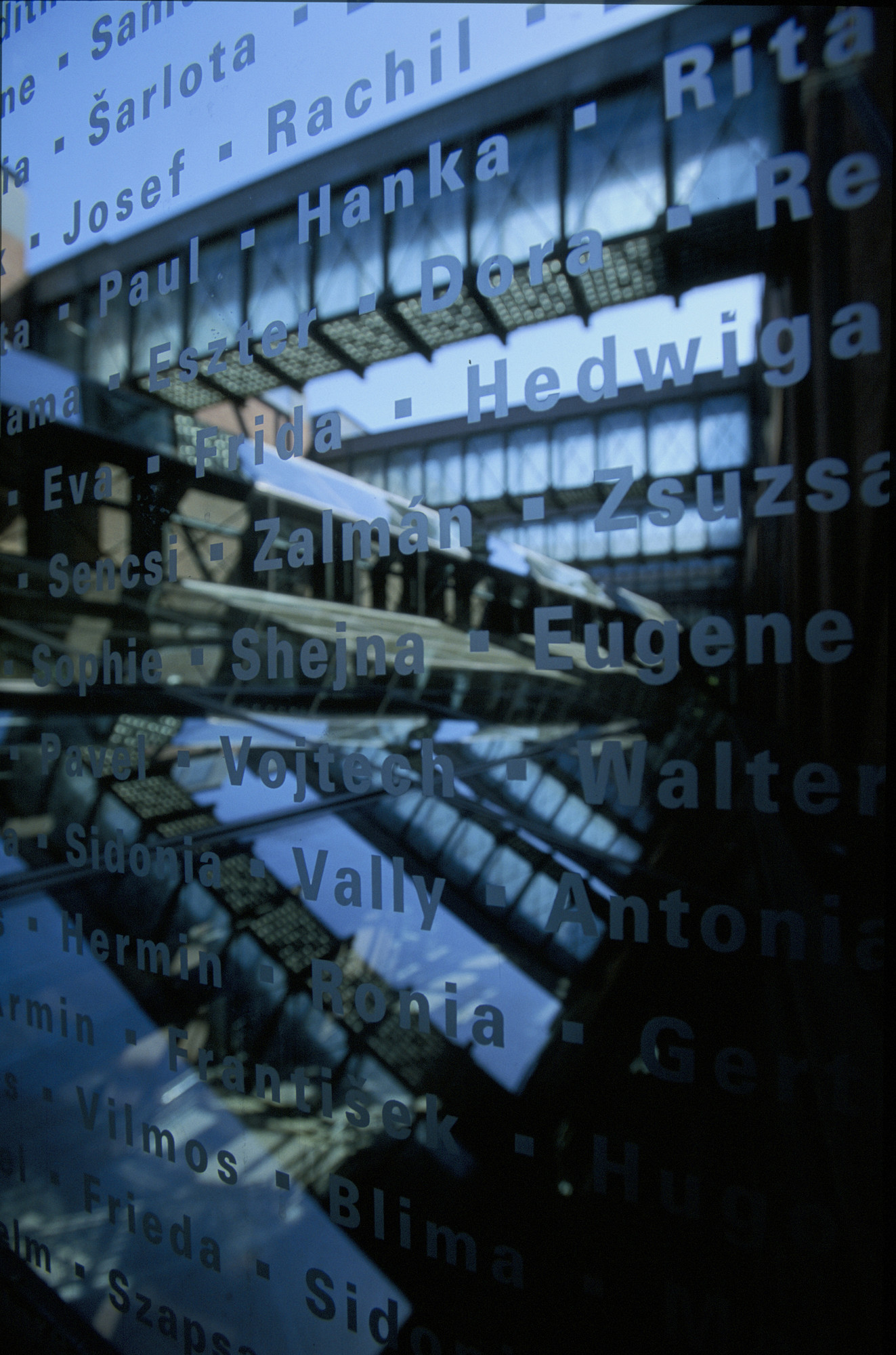 One panel of the glass etched with the first names of Holocaust victims that lines the bridge in the permanent exhibition of the U.S. Holocaust Memorial Museum.