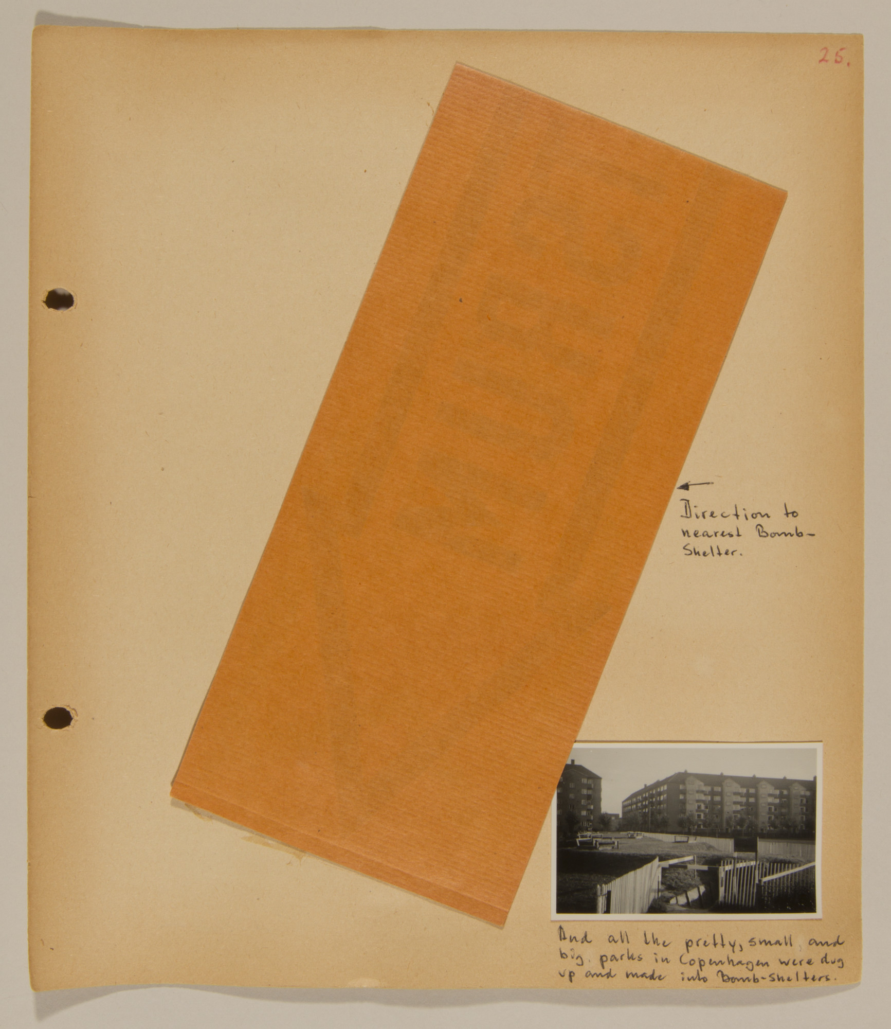 Page from volume one of a set of scrapbooks compiled by Bjorn Sibbern, a Danish policeman and resistance member, documenting the German occupation of Denmark.  This page contains a sign to a bomb shelter.