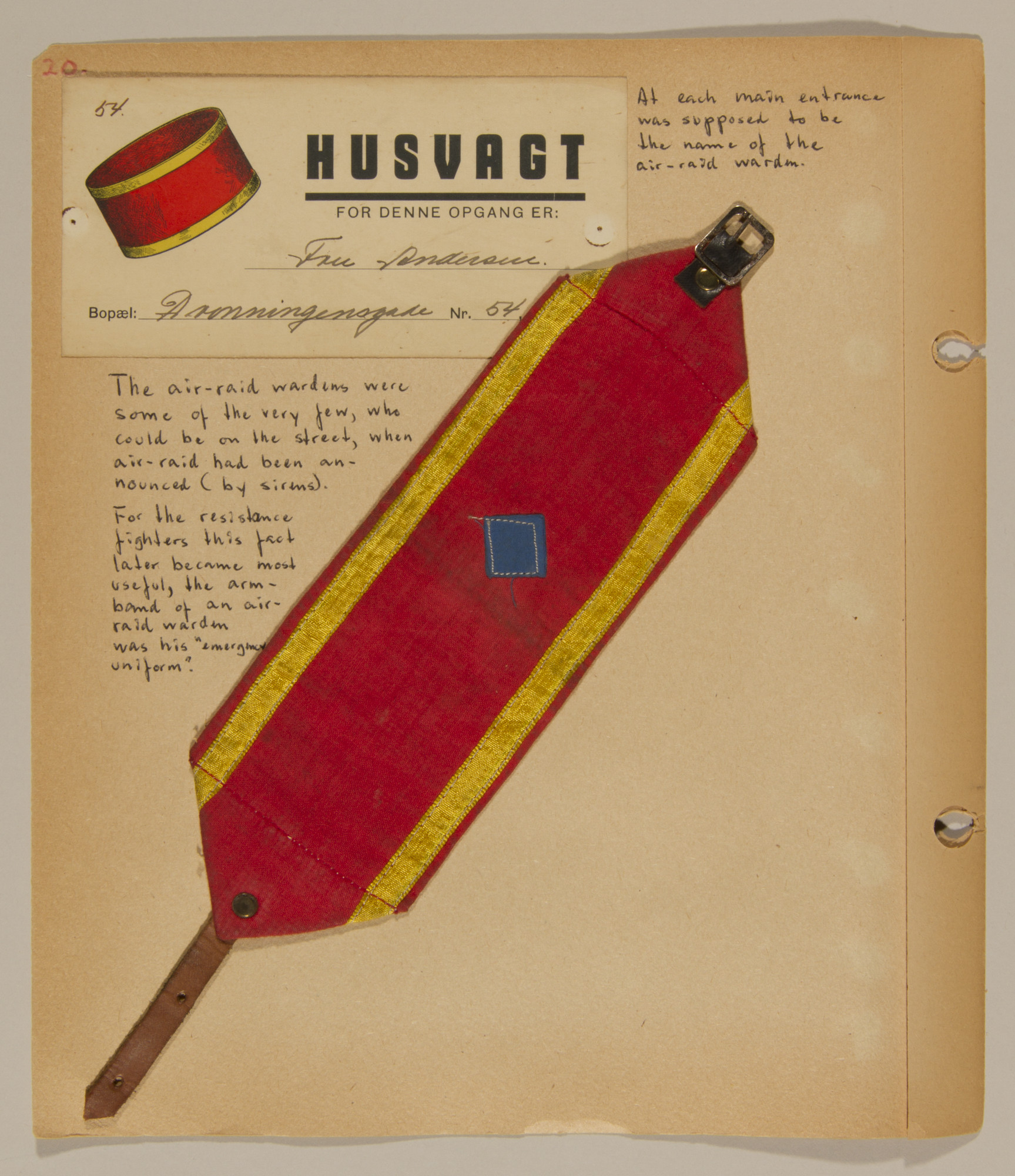 Page from volume one of a set of scrapbooks compiled by Bjorn Sibbern, a Danish policeman and resistance member, documenting the German occupation of Denmark.  This page contains the cloth armband of an air warden.