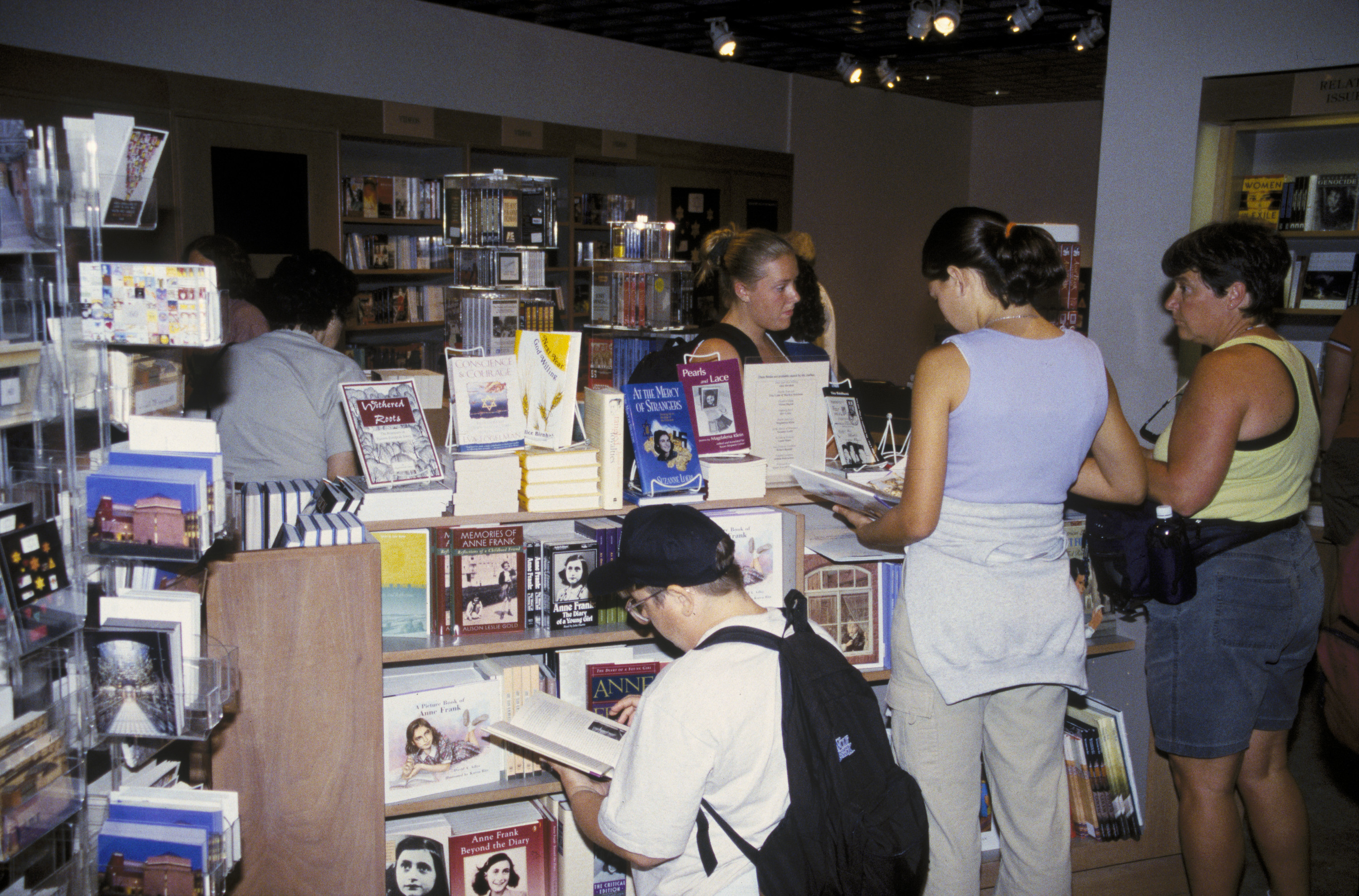 Visitors in the museum shop and bookstore on the first floor of the U.S. Holocaust Memorial Museum.