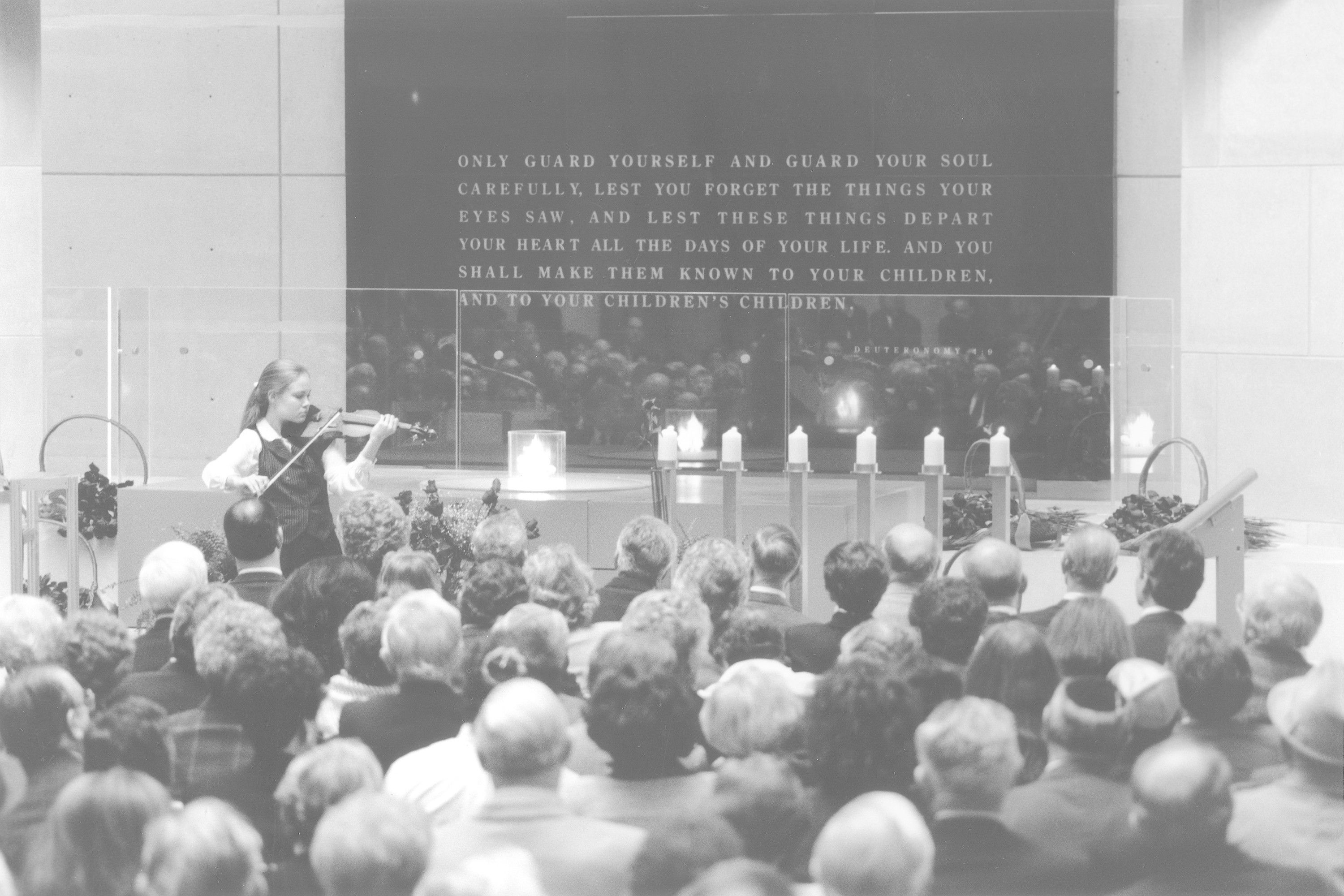 Violinist Leila Josefowicz performs in the Hall of Remembrance during the 50th anniversary commemoration of the liberation of Auschwitz-Birkenau at the U.S. Holocaust Memorial Museum.