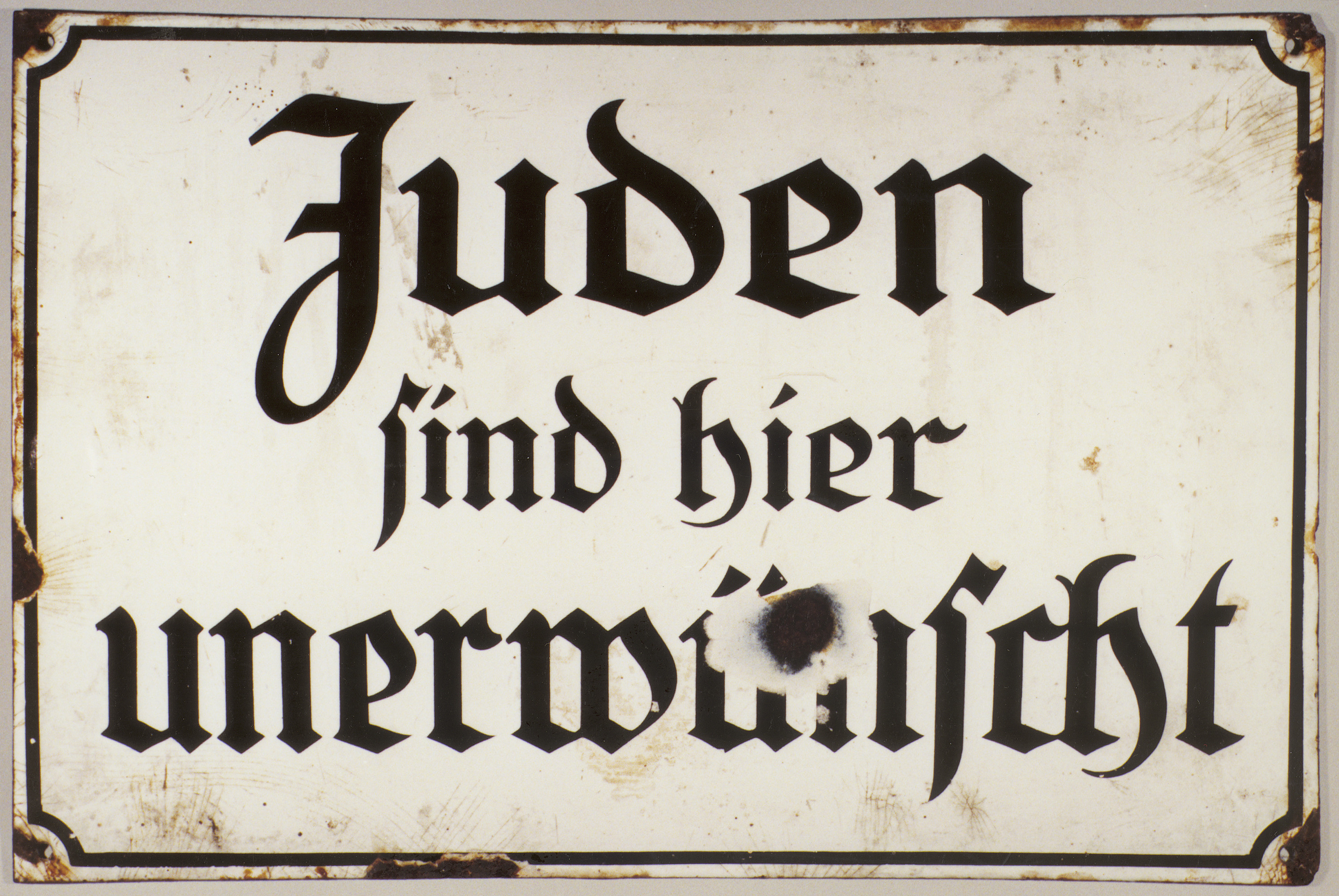 Anti-Semitic sign that reads Juden sind hier unerwunscht (Jews Are Unwanted Here).
