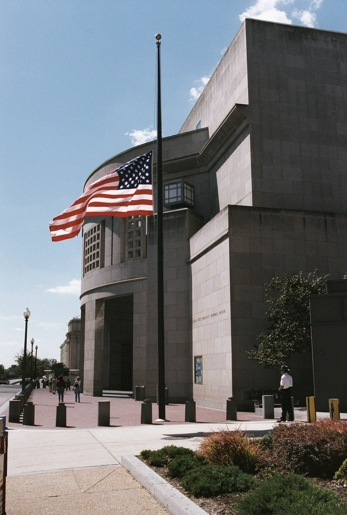View of the 14th Street entrance to the U.S. Holocaust Memorial Museum, in which the American flag is flying at half mast to commemorate the first anniversary of the September 11, 2001 terrorist attacks.