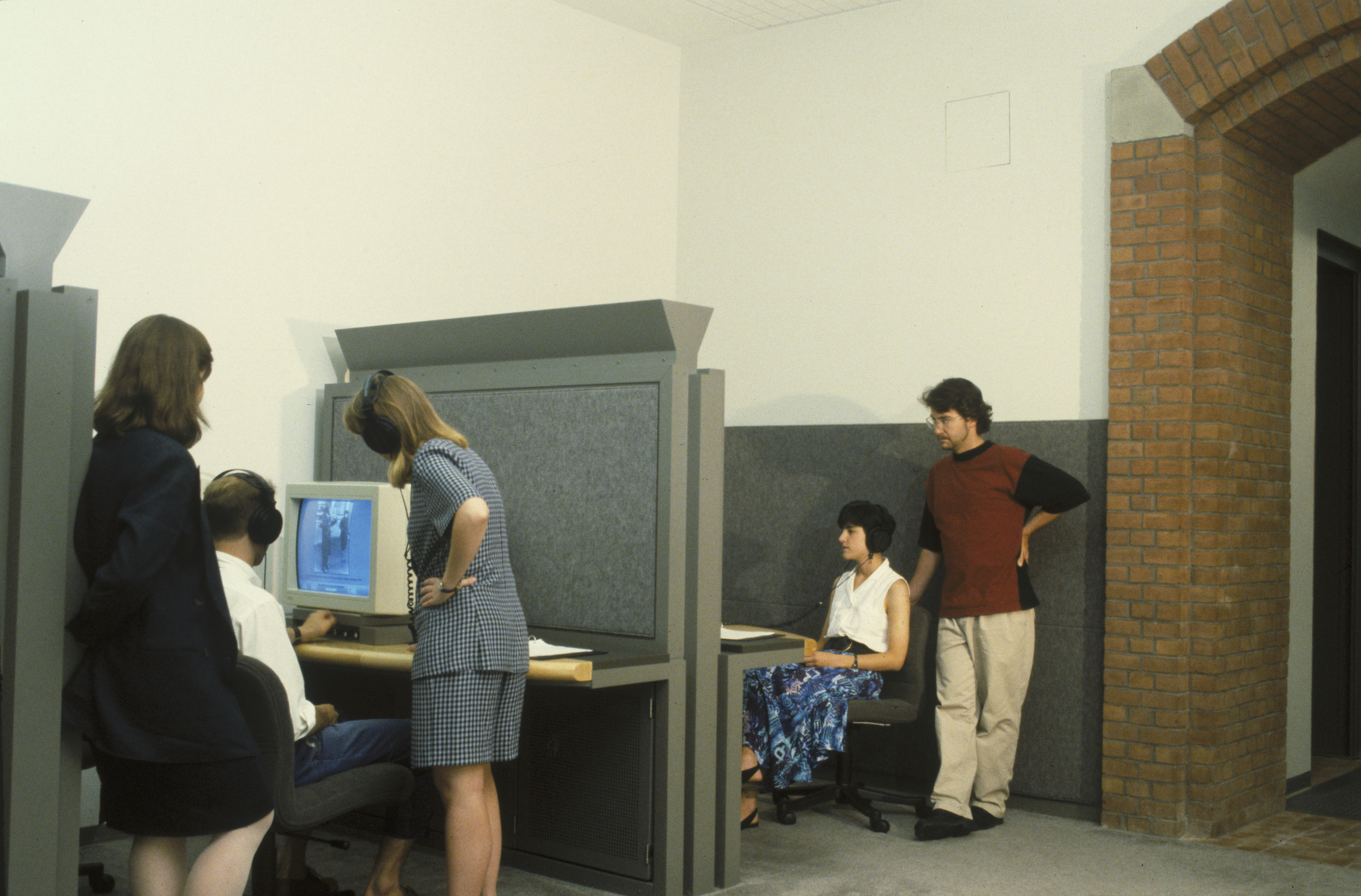 Visitors using computer terminals in the Wexner Learning Center at the U.S. Holocaust Memorial Museum.