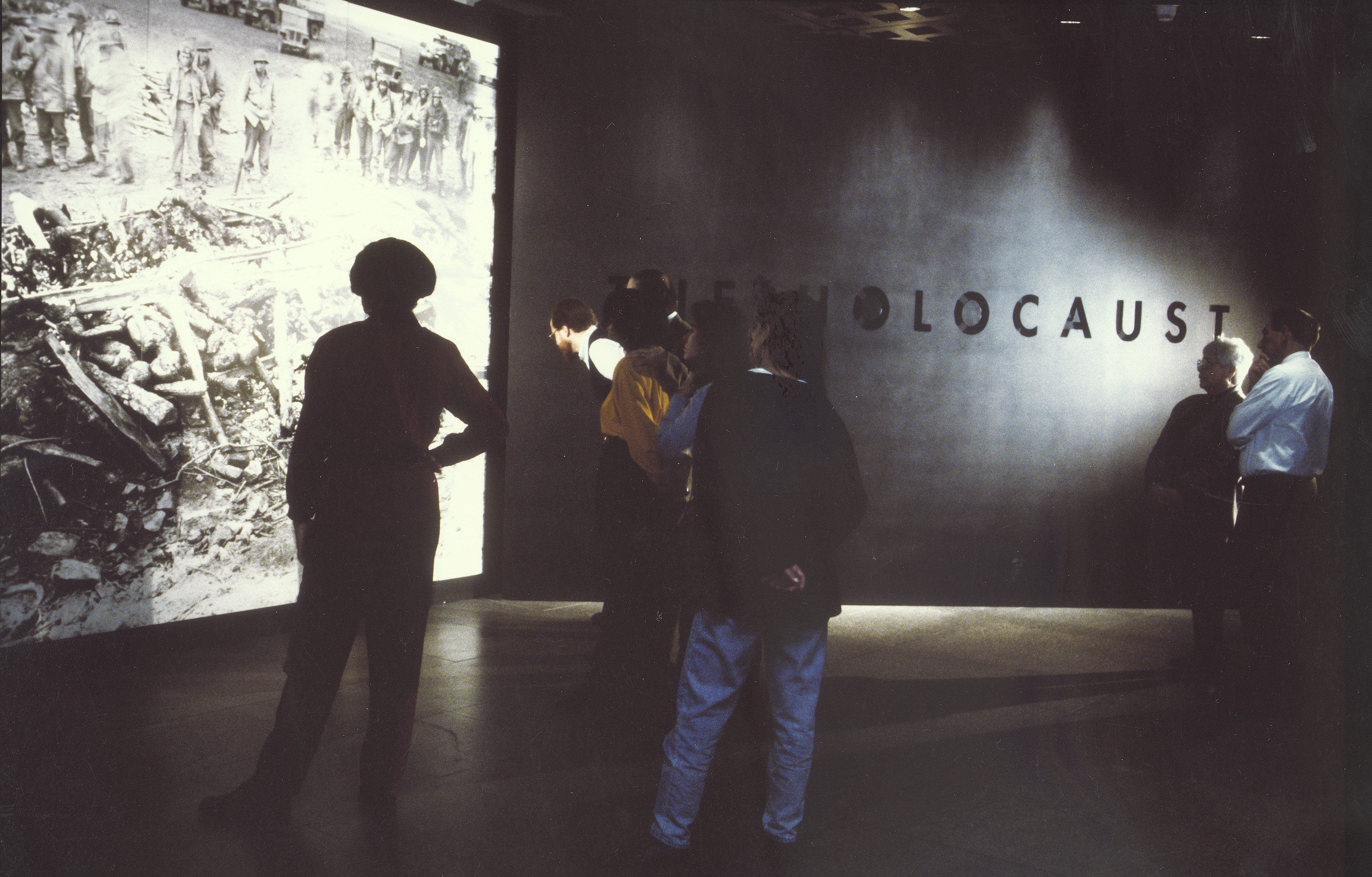 Visitors view the liberation mural on the fourth floor of the permanent exhibition in the U.S. Holocaust Memorial Museum.