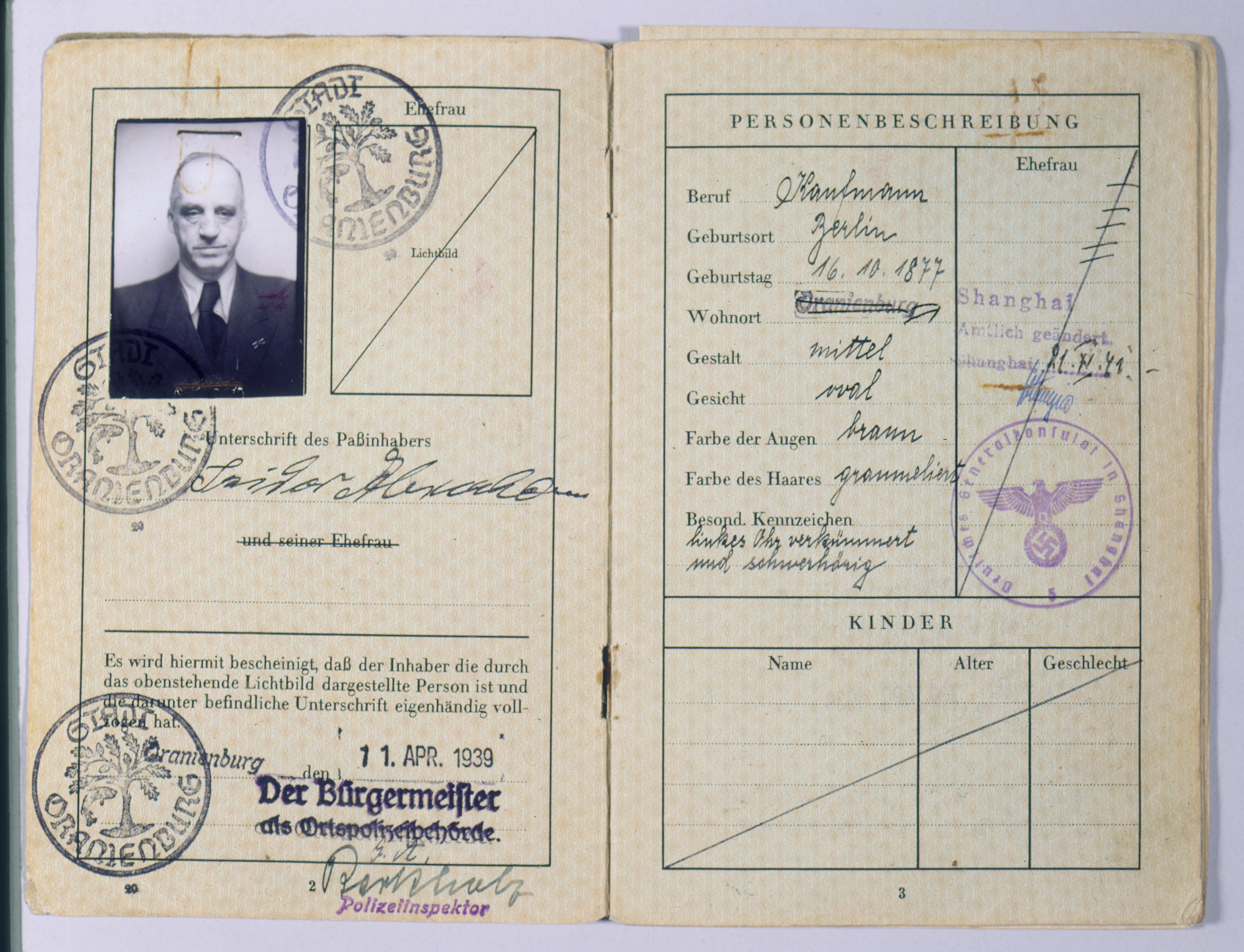 "Pages two and three of the German passport issued to Isidor Abraham (the grandfather of the donor's wife) on April 11, 1939.   Persecution of Jews in Hitler's Reich intensified in 1938. All passports held by Jews were stamped with a red ""J."" Fleeing Germany after the nationwide, Nazi-organized attacks on Jews and Jewish property during November 8-9, 1938 (Kristallnacht), Isidor Abraham's family emigrated from Berlin to Shanghai, which did not require a visa for entrance. Abraham later died in Shanghai."