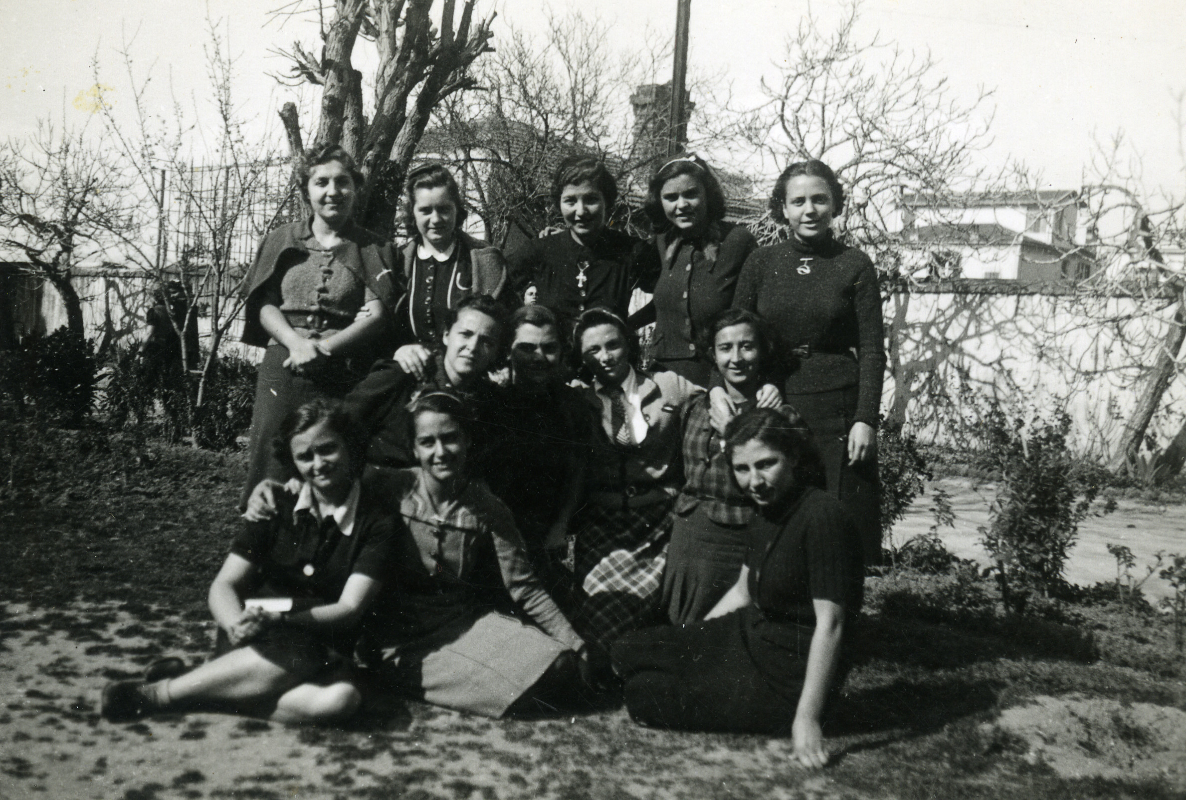 Class photo in a garden in Salonika, March 1939.  Jenny Ezratty is pictured the middle of the center row.