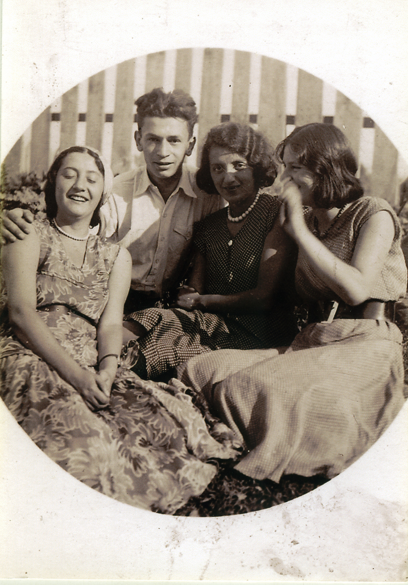 Riva and Dimo Szrajer (far left) sit outside with friends.