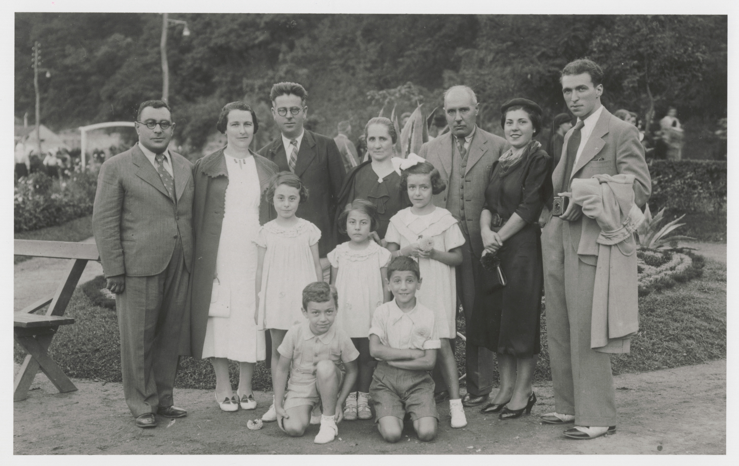 A group of friends on summer vacation at the sulfur baths at Vranjska Banja.  Among those pictured are Mato (nee Franco) Nahmias (back row, fourth from left), Avram Nahmias (back row, third from right), and Victor Nahmias (kneeling in front, on the right).