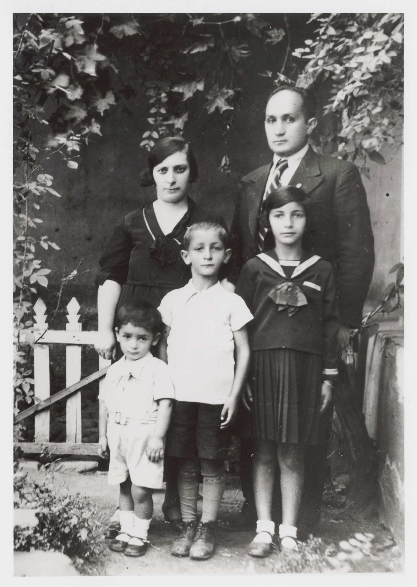 Portrait of the Nahmias family.  Pictured are parents Elvira and Isaac, with children Albert, Victor, and Stella.