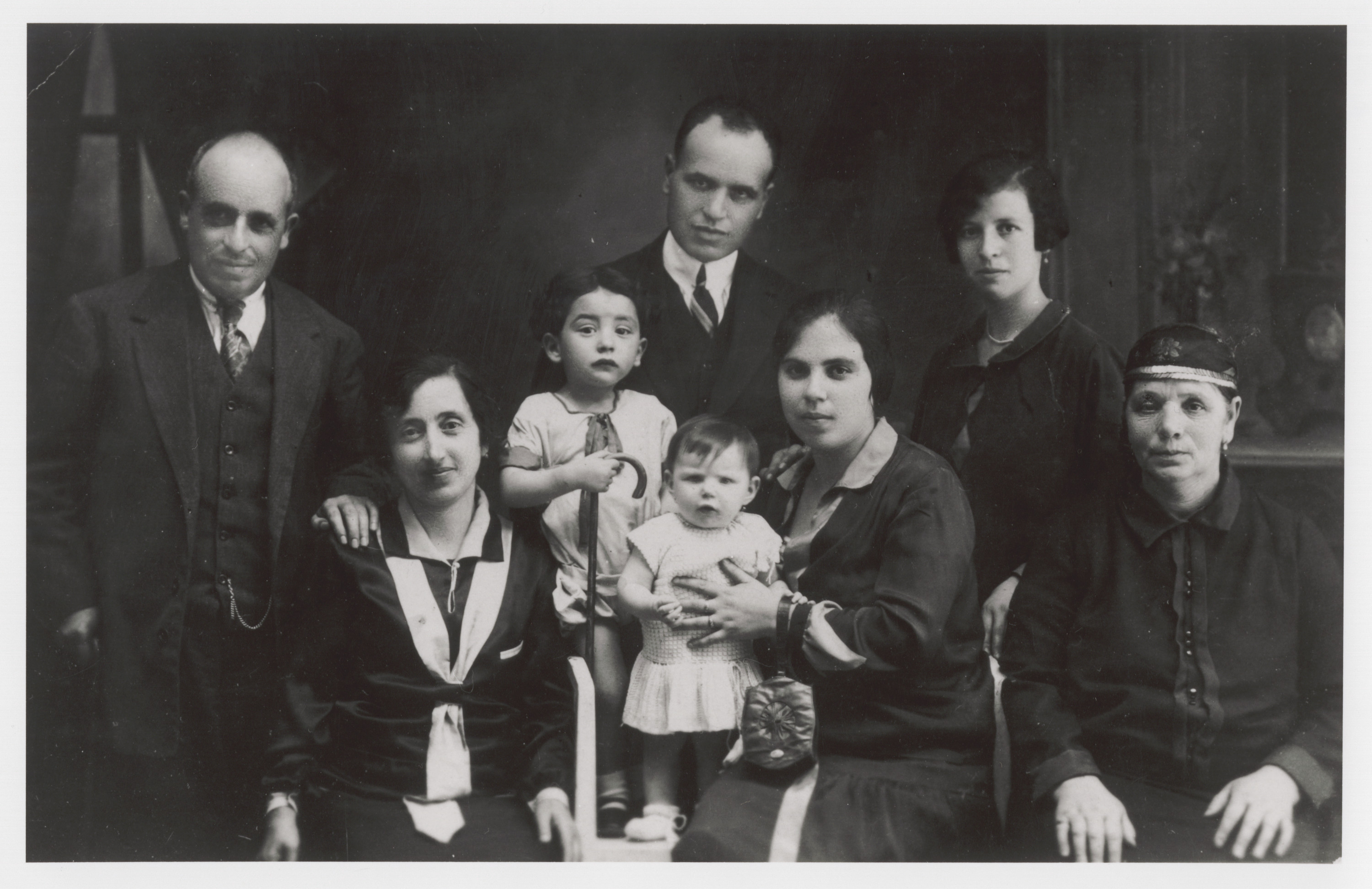 "Portrait of a Jewish family in Monastir (Bitola).  Among those pictured are (standing in back, left to right) Mr. Shami and Mr. Shami (brothers), and [an unidentified woman]; (seated, left to right) the sister of Mrs. Mayo (who was a cousin of Avram Nahmias), [an unidentifed child], Allegra (""Gita""), Sara Shami (sister of Rachel Nahmias' brother-in-law, Samuel Levy), and ""Grandma"" Shami."