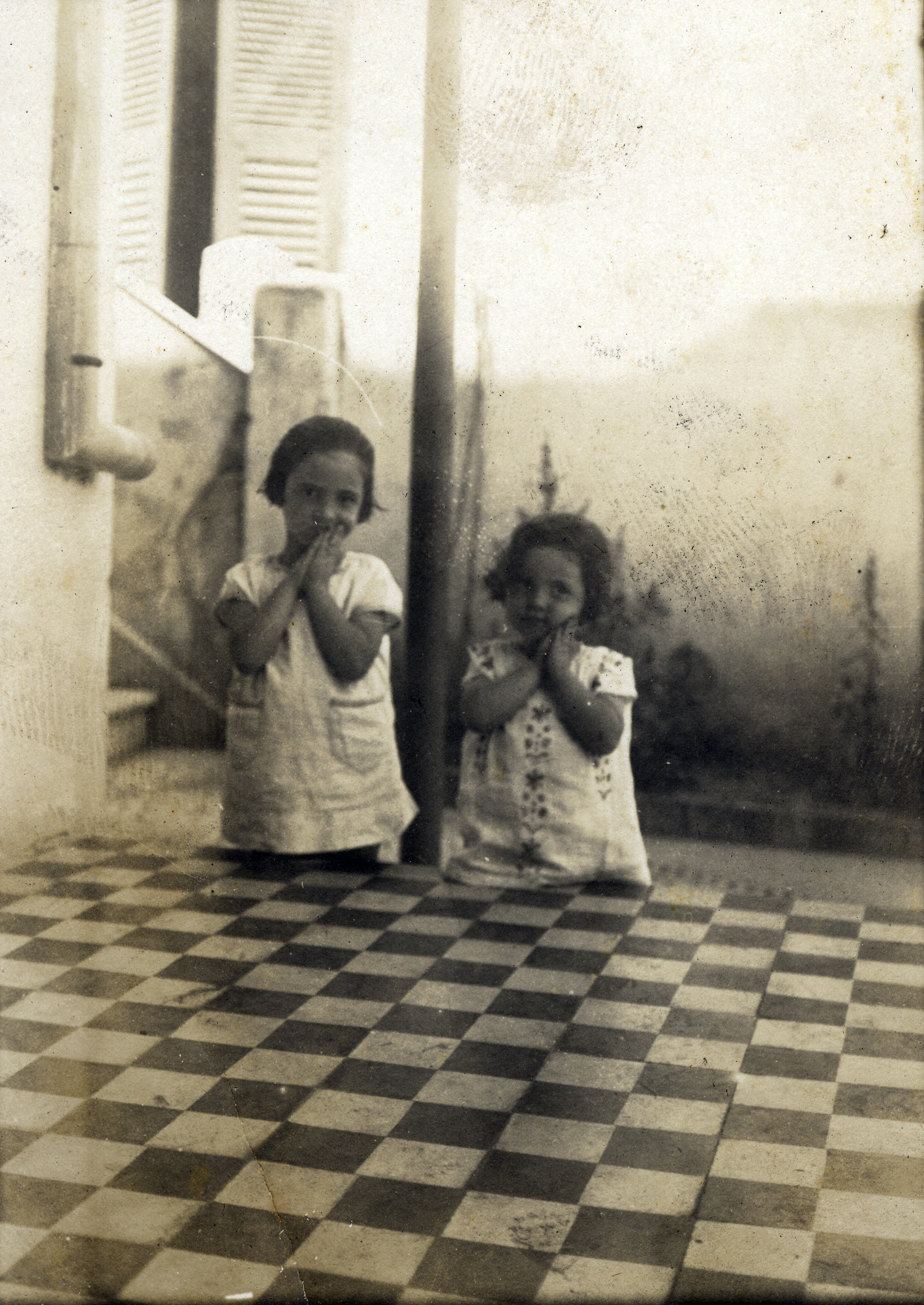 Close-up of two young girs; Esther (right) and Jenny Ezratty (left) in Salonika around 1922-1923.