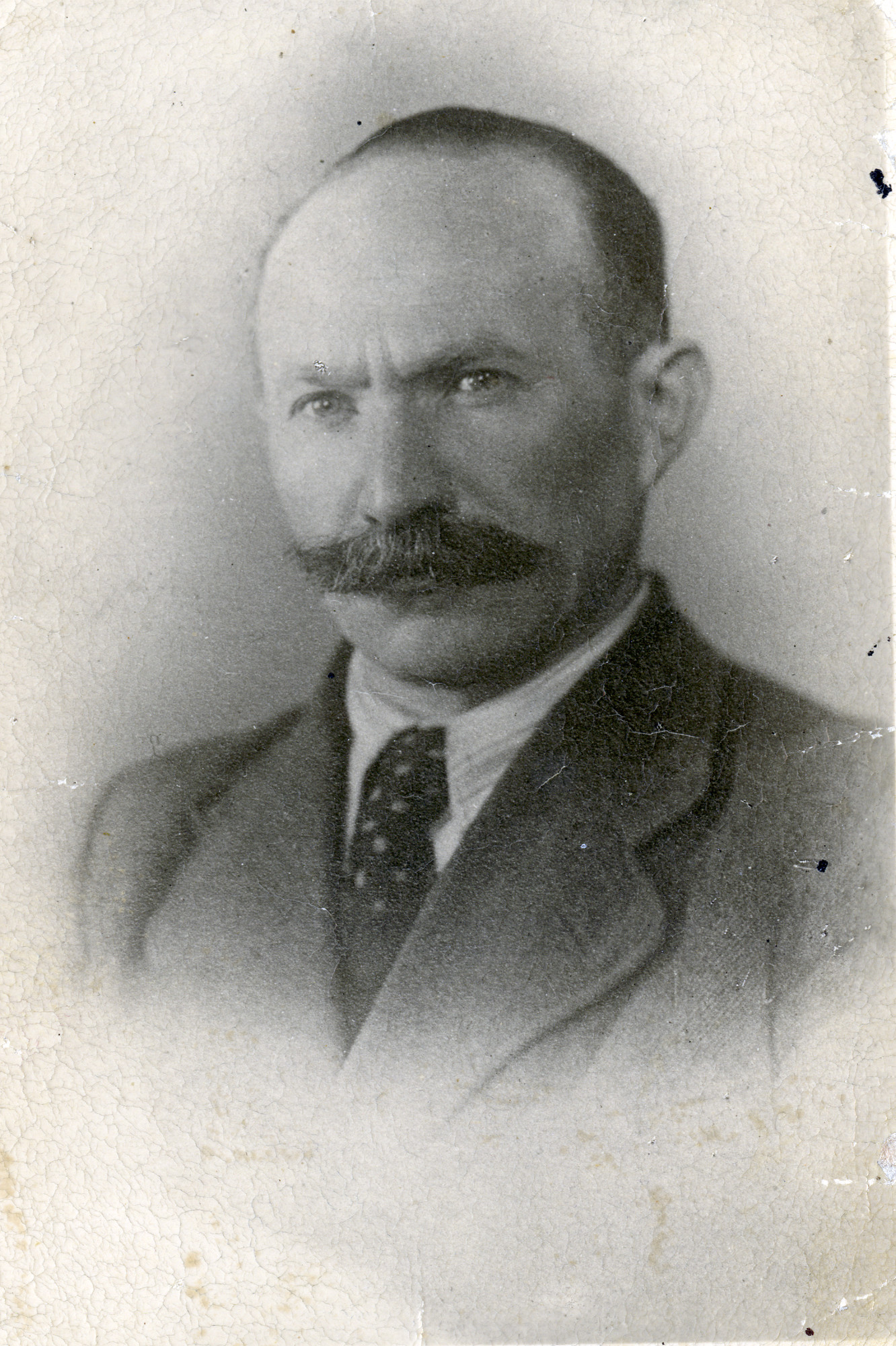 Studio portrait of Israel Miedzyrzecki while posing as a Christian named Stephan.