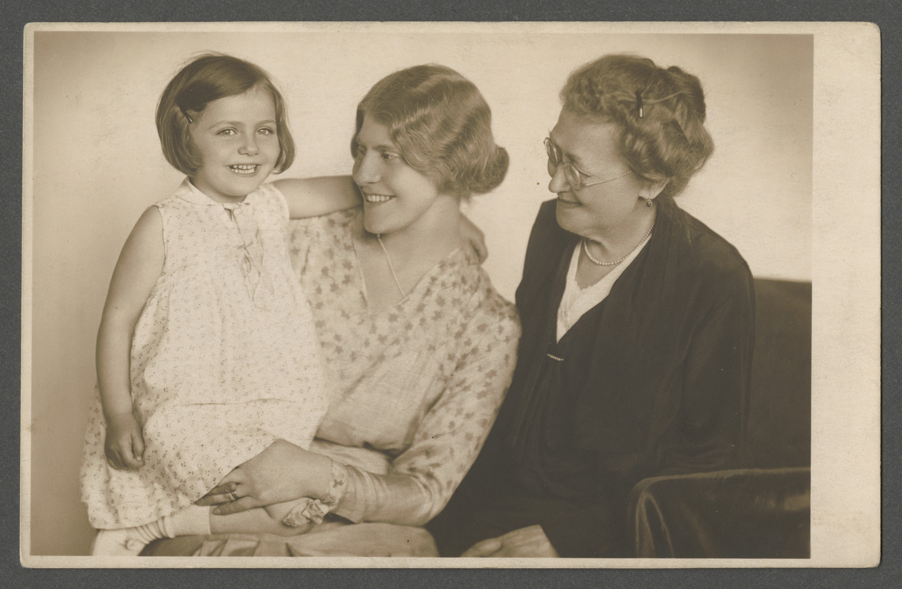 Three generation photograph of a grandmother, mother, and daughter.  Pictured (left to right) are Renee and Louise Goldschmied, and Rosa (nee Loewenthal) Ohs.