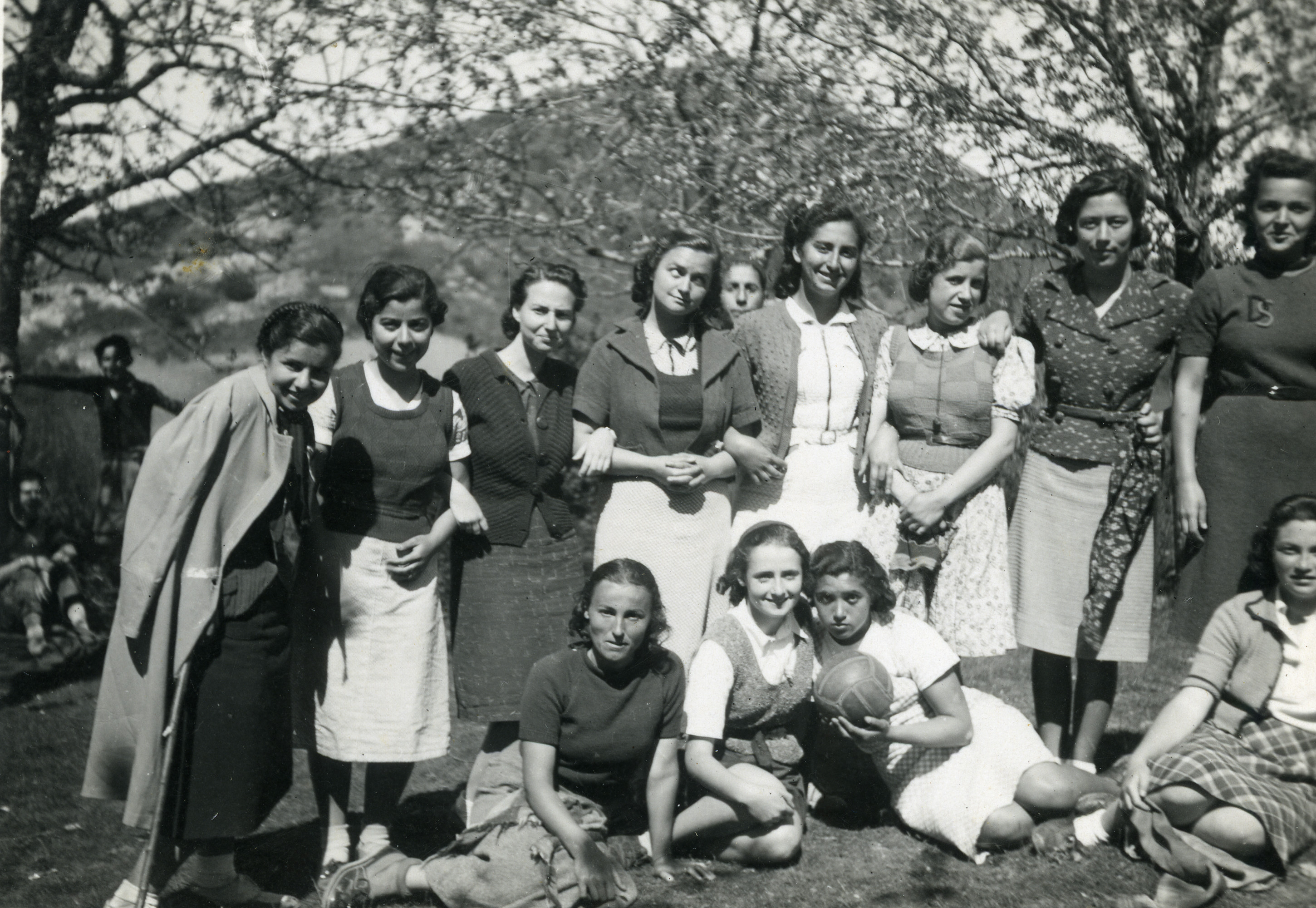 Group of students having a picnic with the athletic club in Salonika, on May 1st 1939.  Among those pictured is Jenny Ezratty, front row, furthest to the right.