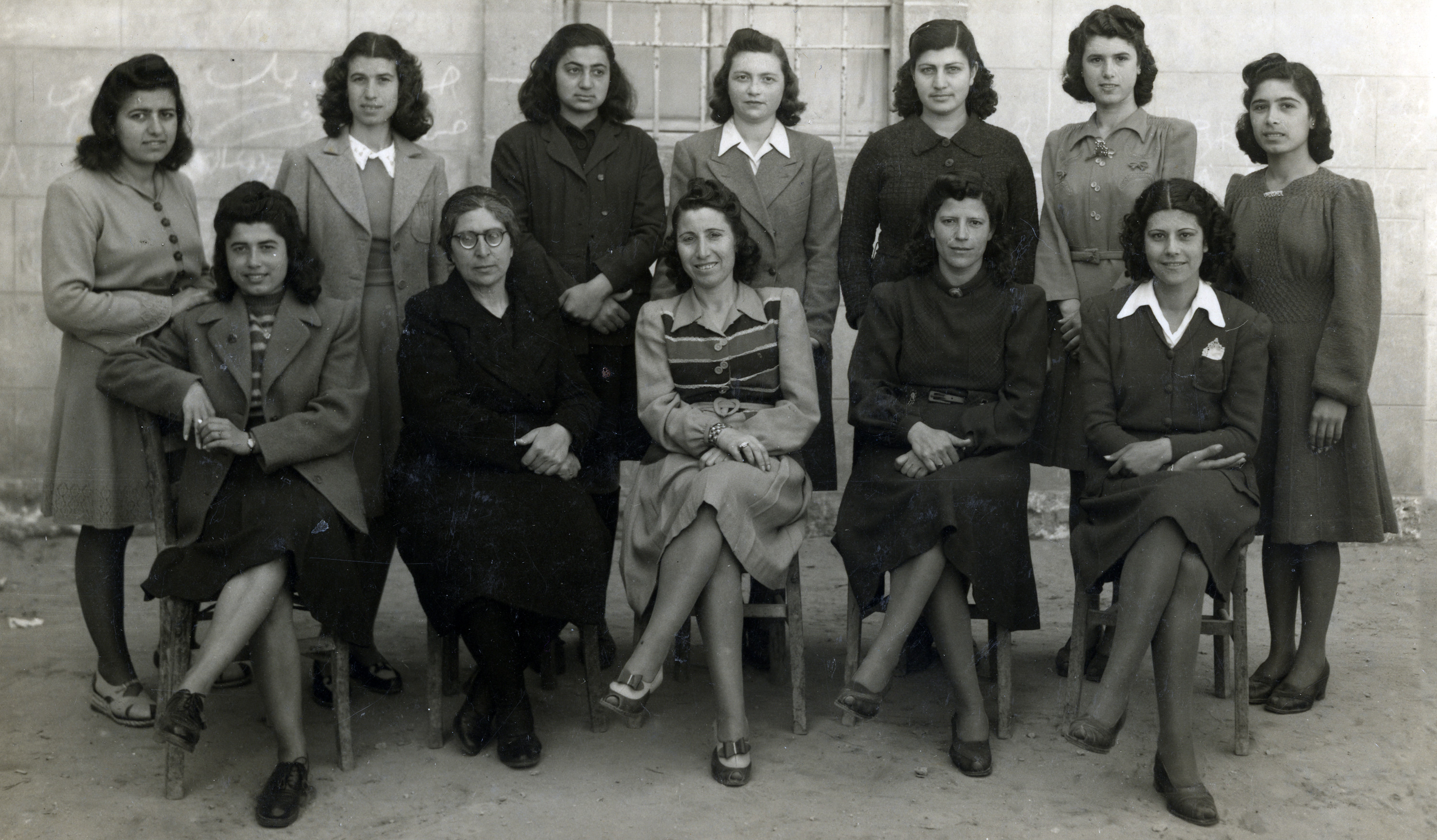 Group photo of students in a Greek Orthodox school in Jaffa in 1945.  Among those pictured is the teacher Jenny Noam (nee Ezratty), top row fourth from the left.