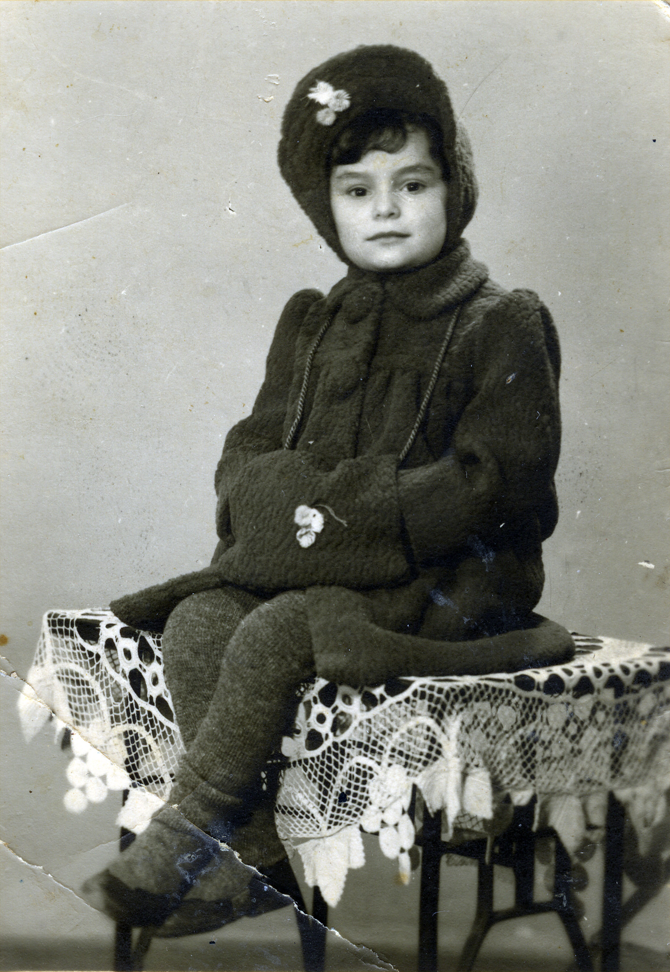Basia Szrajer poses for a studio portrait in winter clothing sent from the U.S. Committee.