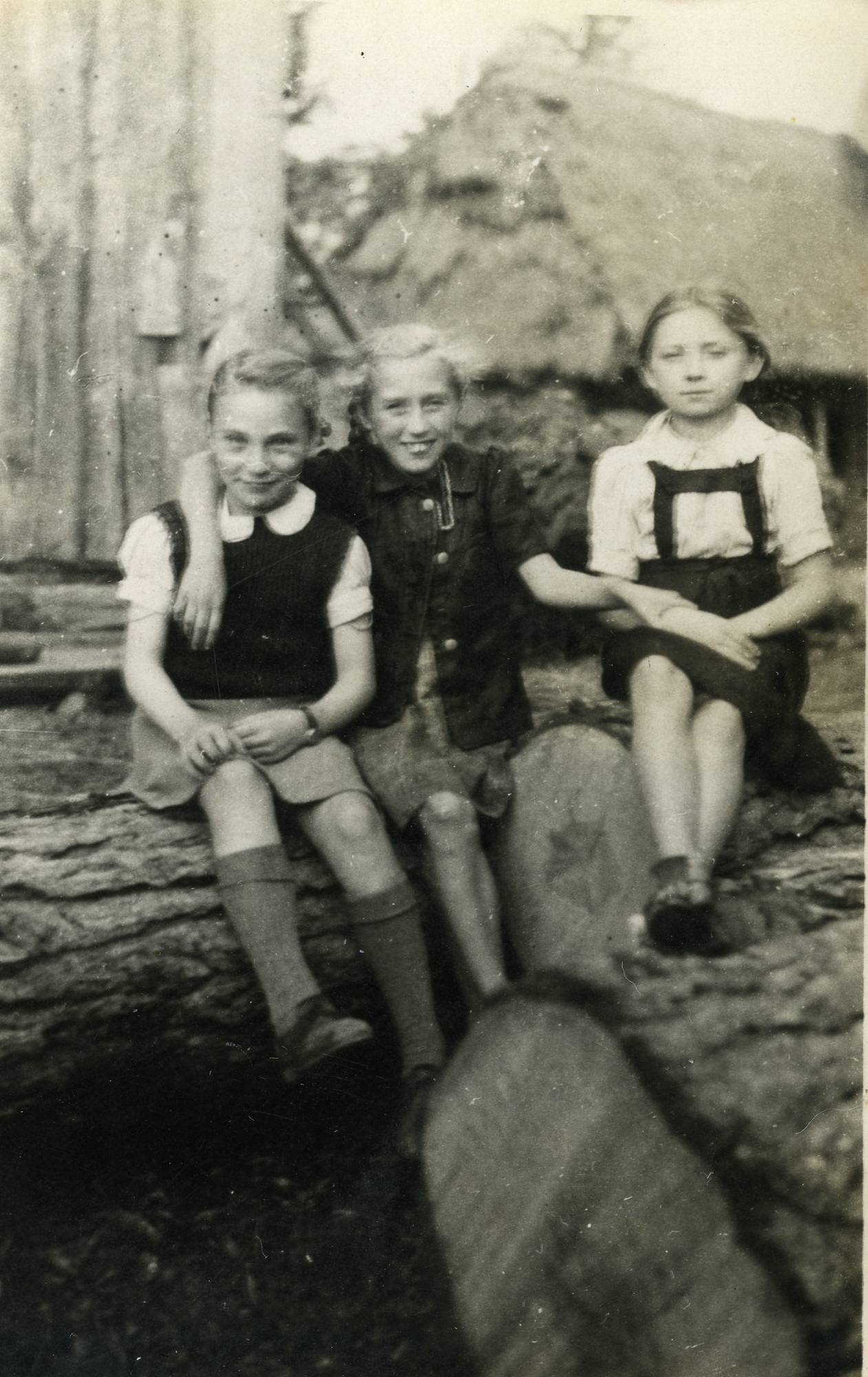 Genia Miedzyrzecka (far left) poses with two Polish girls while in hiding outside Warsaw.