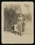 Sonia and Hermann Pressman go for a walk in a city park in Antwerp.