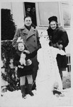 The Starkopf family poses by a snowman in the Feldafing displaced persons camp.