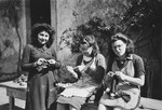 Girls practice knitting in Chateau de la Hille.  Pictured are Gerti Lind, Anne-Marie Piguet (a teacher) and Cilly Stueckler.
