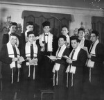 Members of a Jewish choir pose in prayer shawls in a synagogue in Munich.