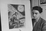 """Metzger, a young artist, displays his painting entitled """"A Dream in the Ghetto""""."""