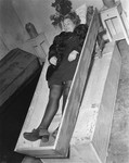 The corpse of a woman lies in an open coffin at the Hadamar Institute where she was put to death as part of the Operation T4 euthanasia program.