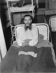 A half-starved survivor sits up in bed at the Hadamar Institute.