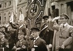 Joseph Goebbels, Franz von Papen and other dignitaries review a gymnastic festival.