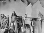 Patients sit in bunk beds in the Kovno ghetto hospital.