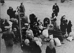 A group of Jews is gathered at an assembly point in the Kovno ghetto during a deportation action.