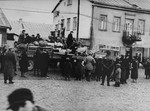 Jews in the Kovno ghetto are boarded onto trucks during a deportation action [probably to Estonia].