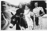 Branka Juhn rides a donkey while on vacation with her mother and grandmother on the Adriatic coast.